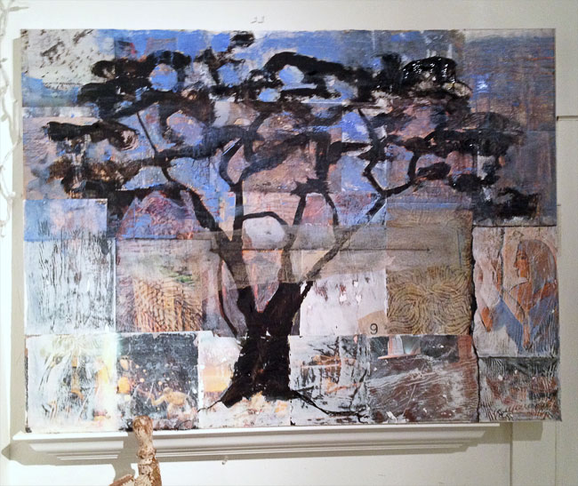 First I collaged squares of altered paper with Ancient Egyptian themes onto the canvas. Then painted an acacia tree over this.