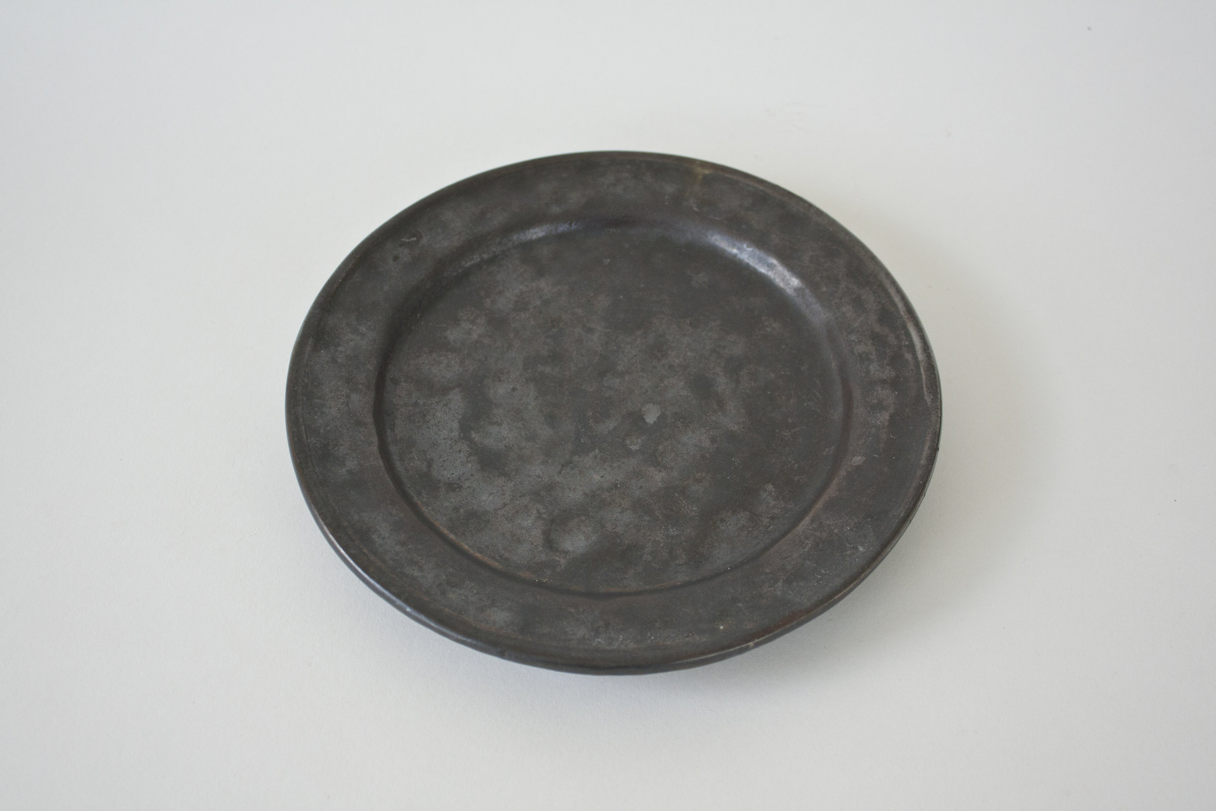 """250. black dimpled plate 