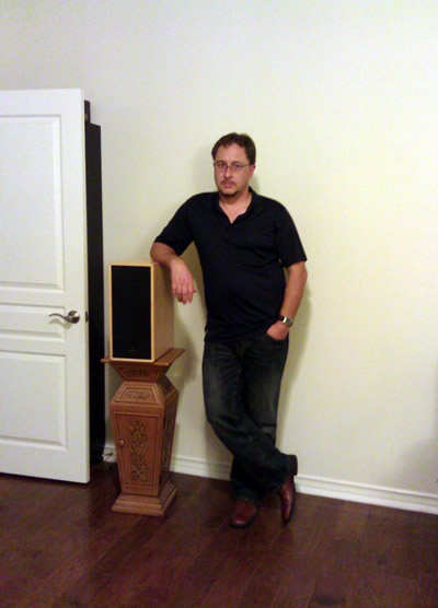 I was going to remove this picture, but it's funny because I should be smiling. This is me standing next to my vintage Talon Audio Khite speakers - still one of the best-sounding speakers I have ever heard. I picked up the pair at a local yard sale for a pittance of $500. When new, the speakers retailed for $4000 - you would think I would have a happier look on my face about this, lol. Seriously, though, re-using (i.e. recycling) old HiFi rather than letting it go to a landfill, is the kind of green thinking we're talking about, here.