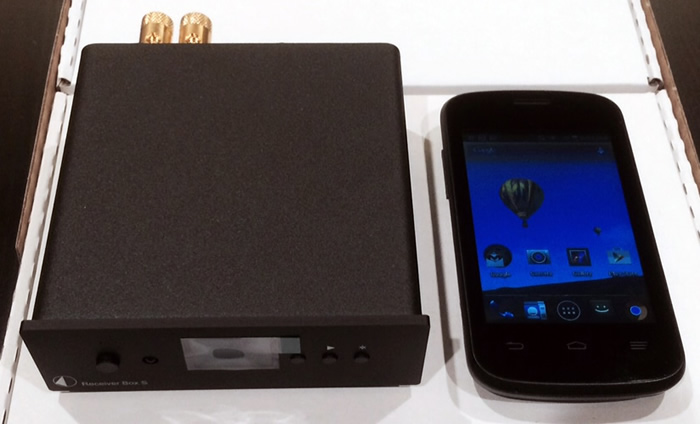 The deceptively small, but incredibly well-built (& heavy) Pro-Ject Receiver Box S, sitting next to my Android phone.