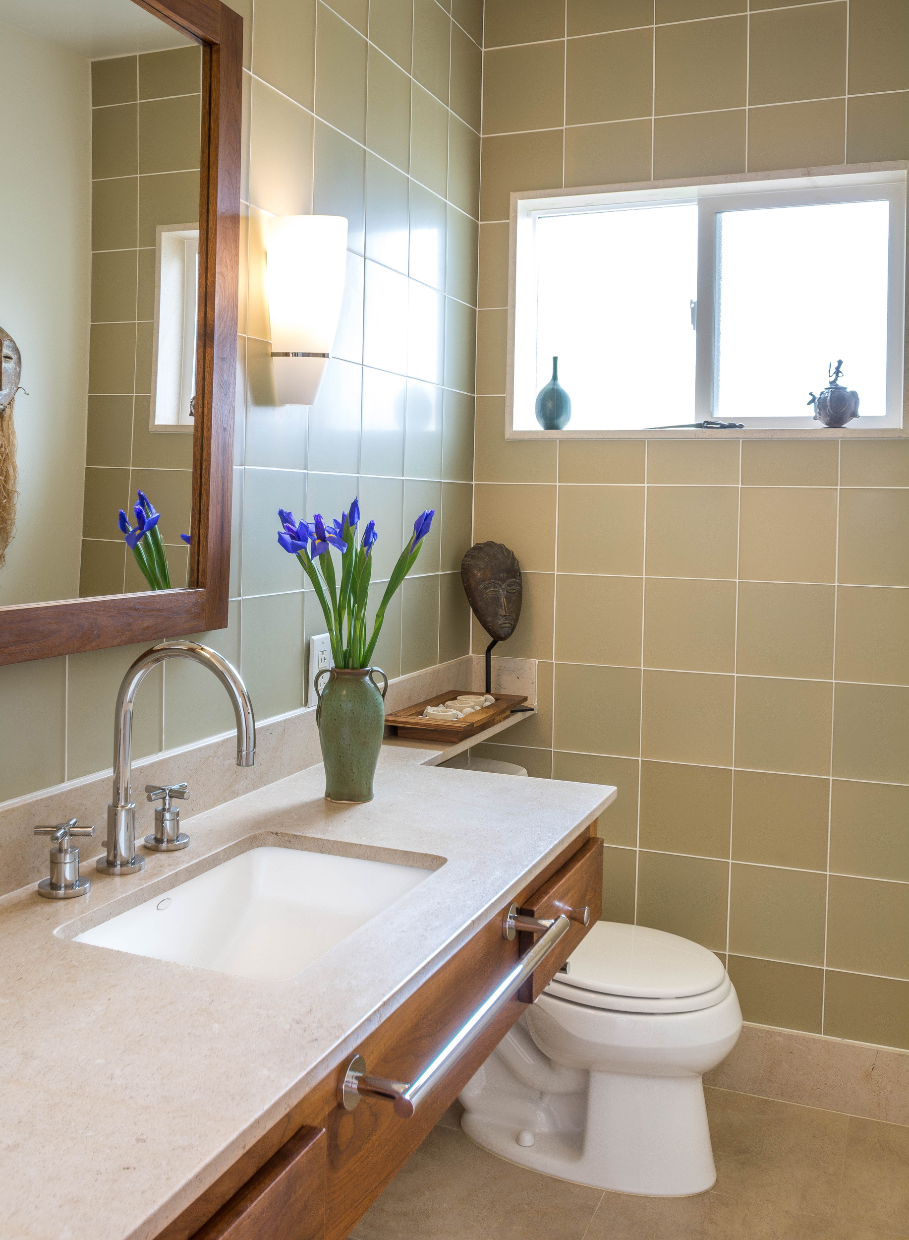 Powder room remodel using matte glass tiles and limestone