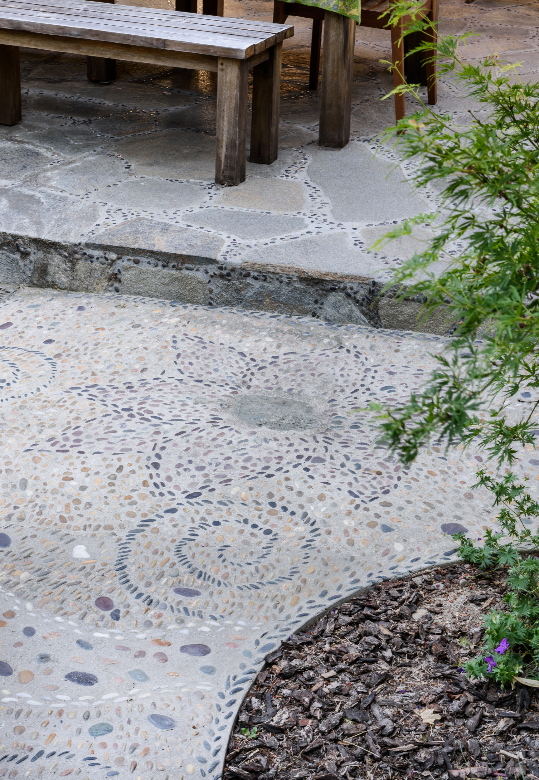 Lotus pebble pathway detail of this Claremont Asian-inspired woodland backyard