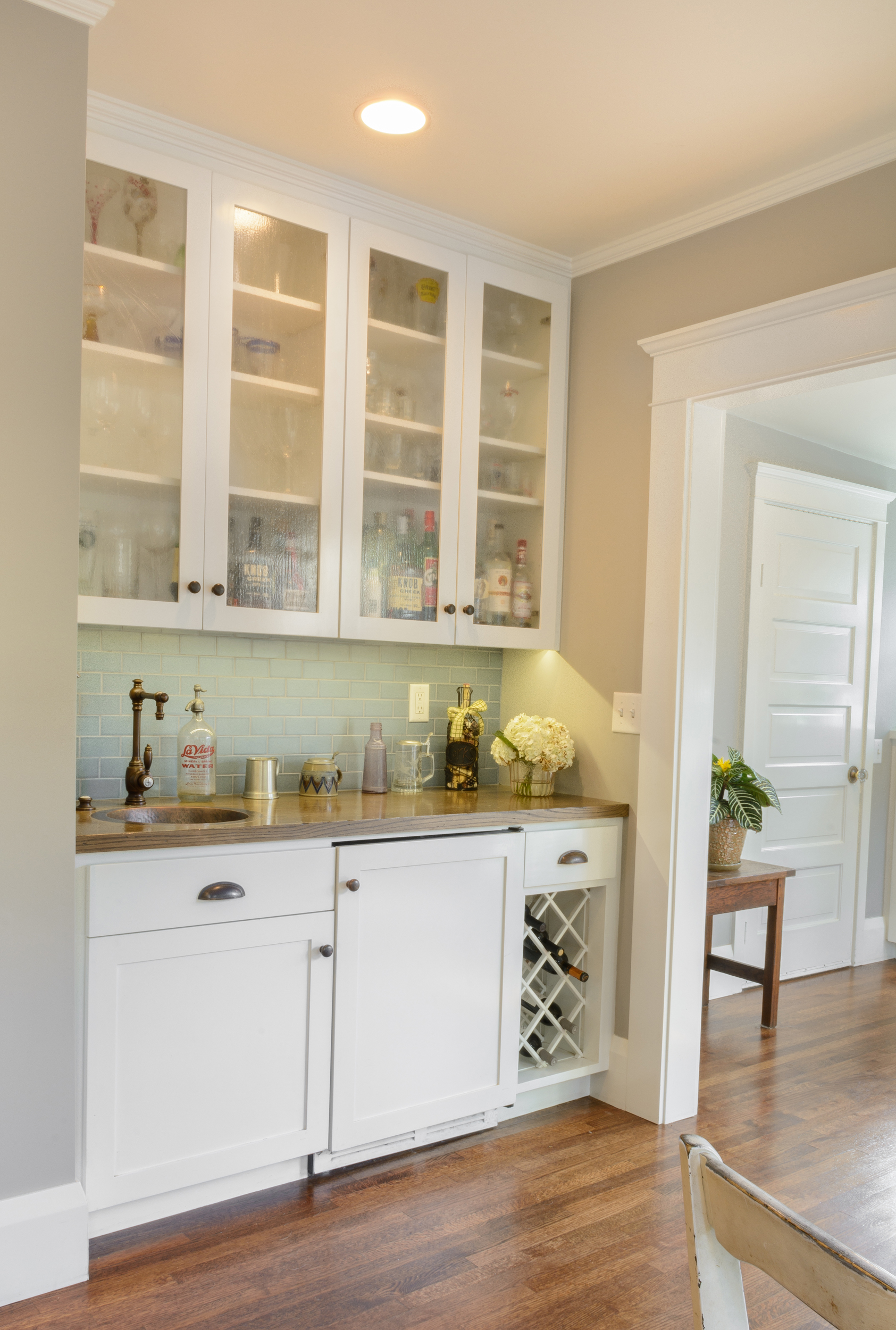 Kitchen bar: white cabinets with glass doors