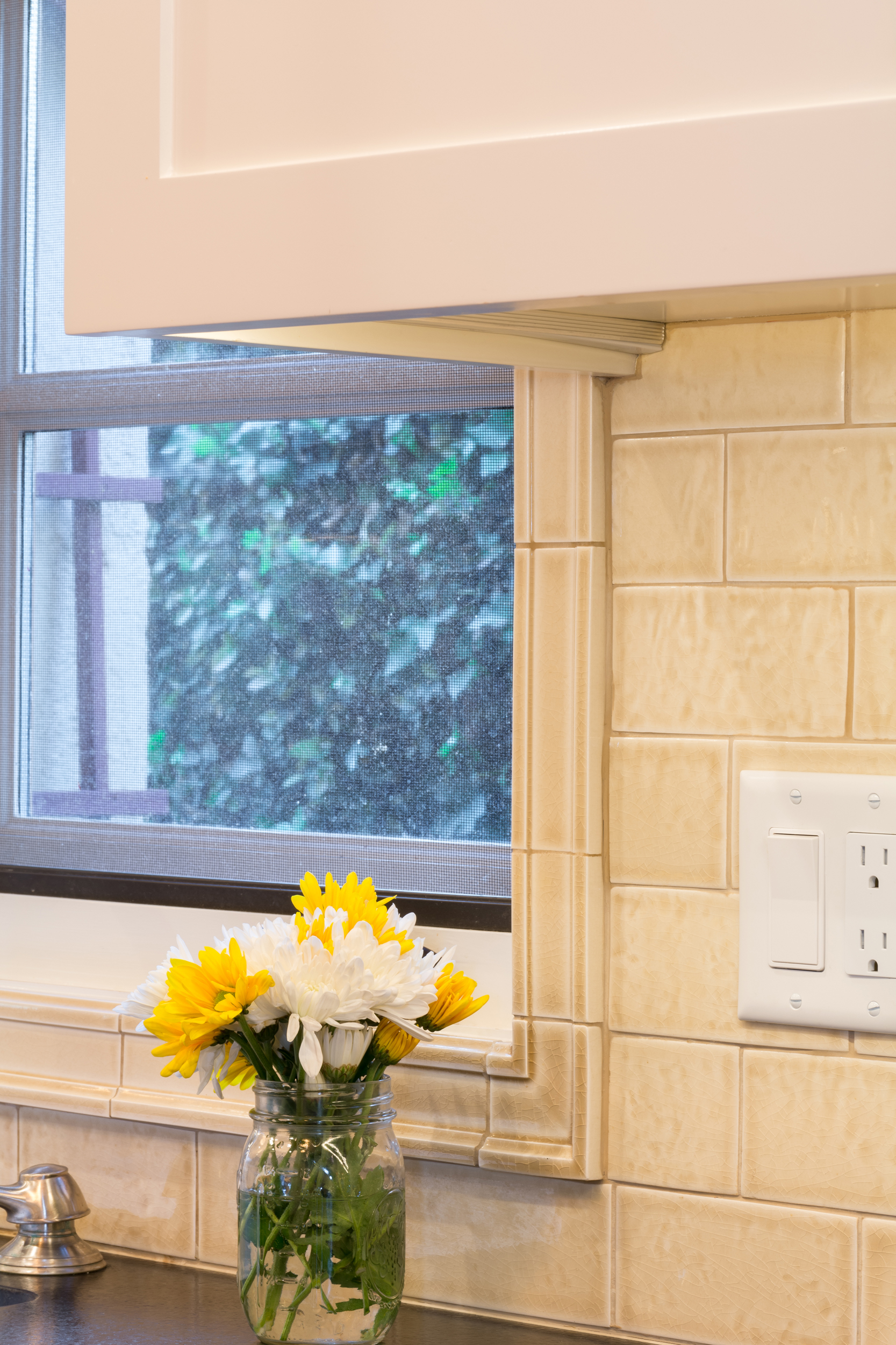 Tile backsplash and window frame