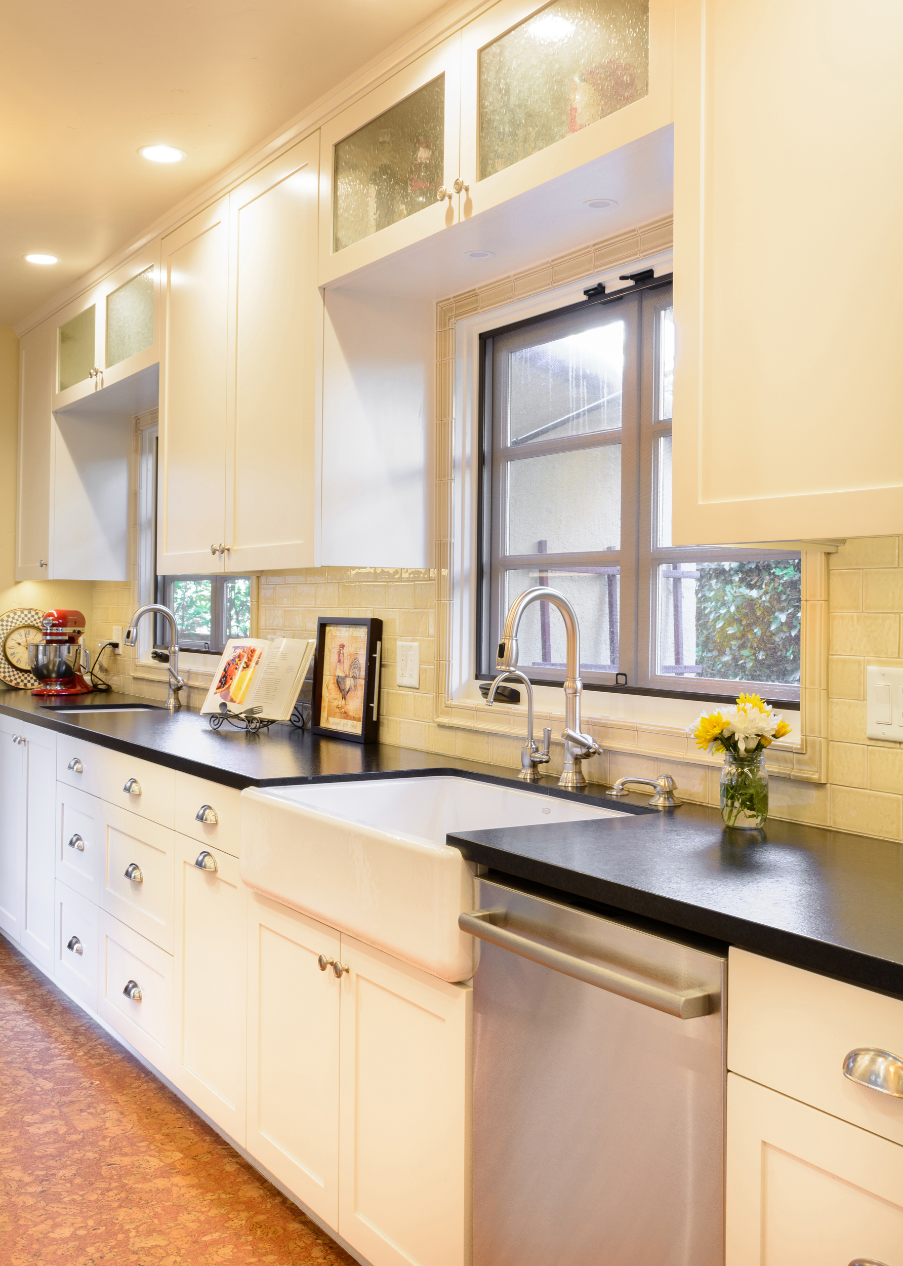 The farmhouse sink, also known as apron sink, constitute another key feature for this old world kitchen