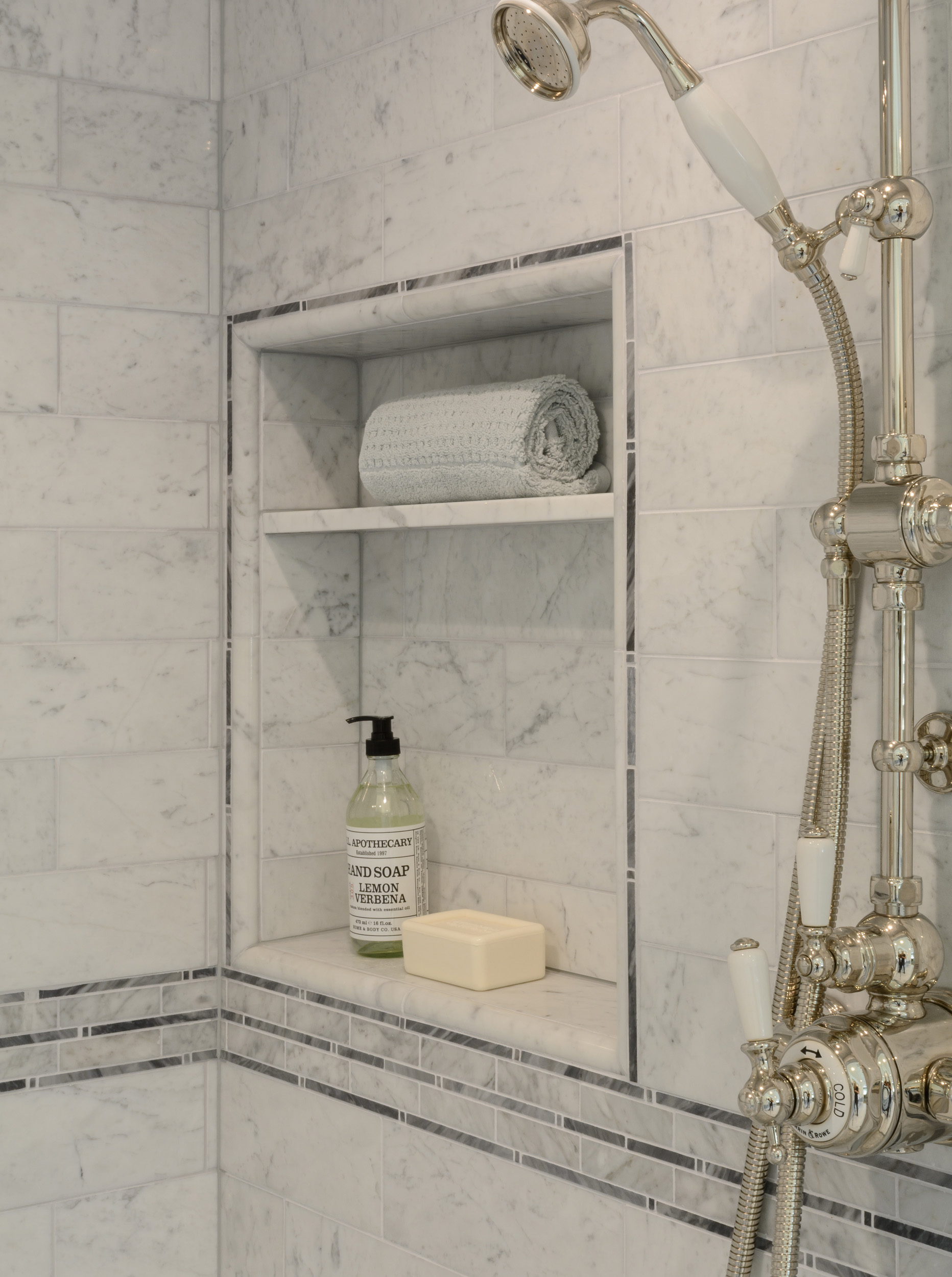 Ultimate luxury: shower niche in carrera marble and traditional handheld shower system