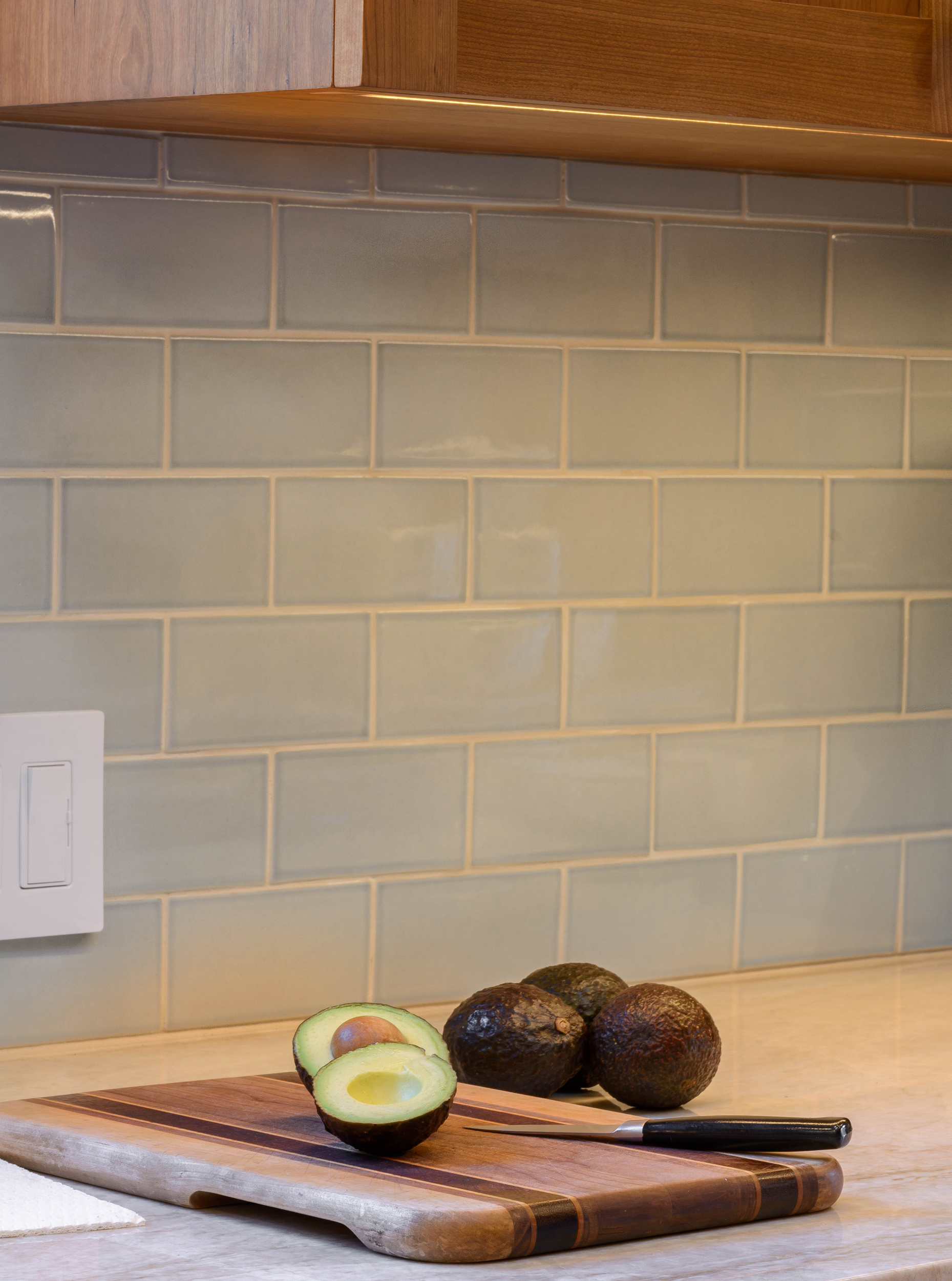 Kitchen stone counter with warm soft blue tile backsplash