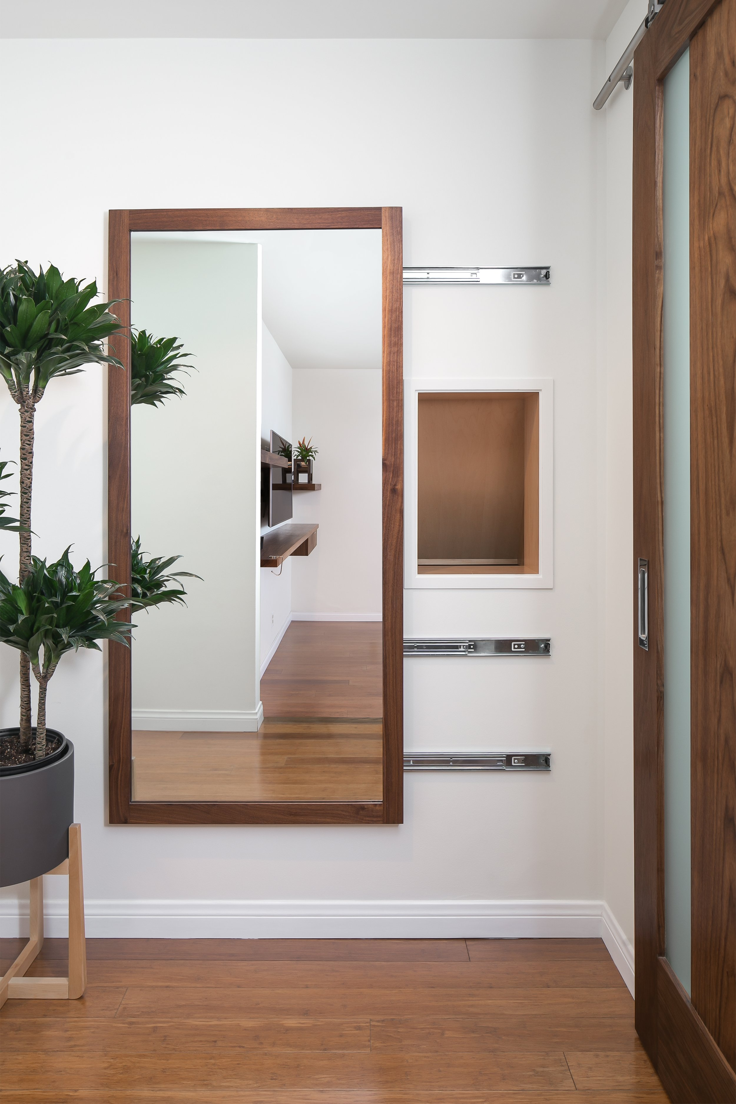 Crafty... the laundry chute is hidden behind a sliding mirror