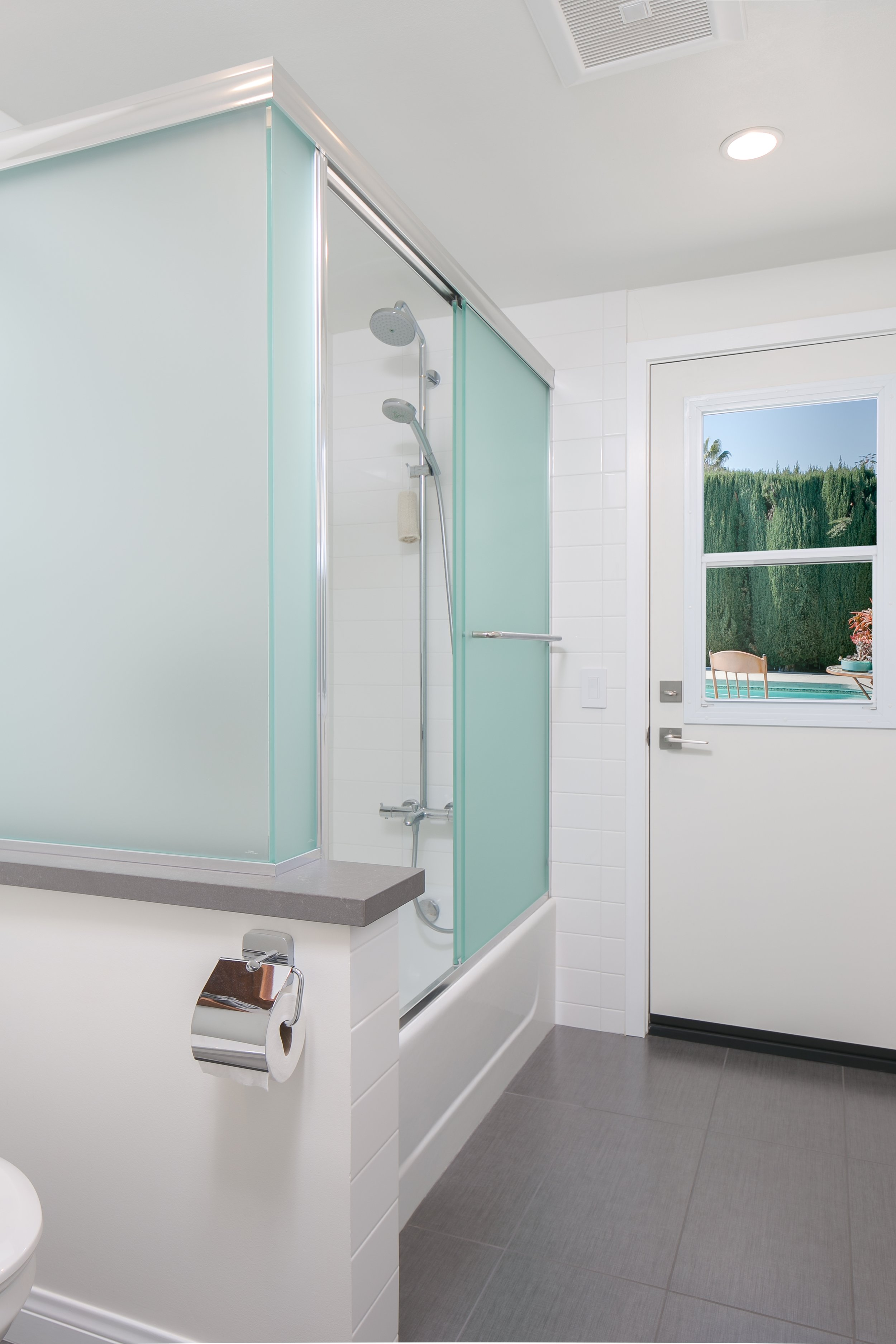 A clean look for this poolside guest bathroom