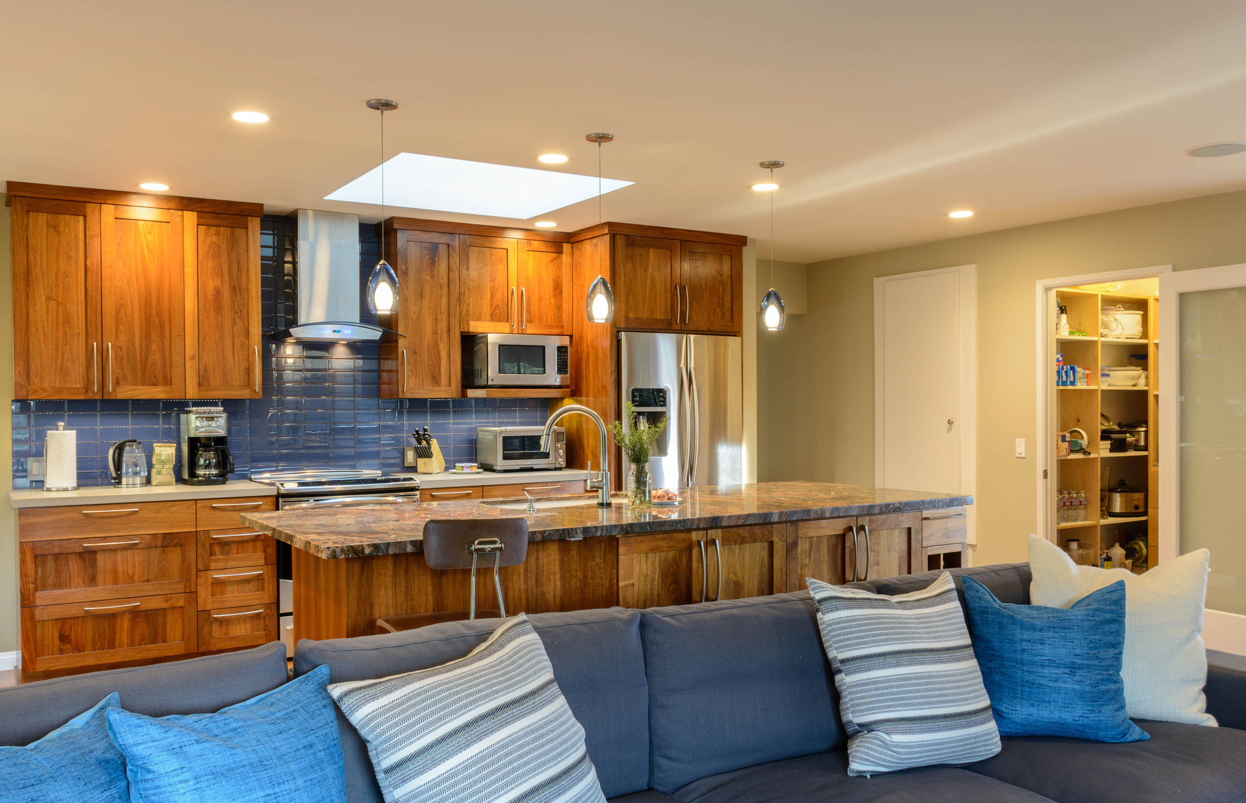 Great room comfort: a blend of walnut, blue and soft lighting