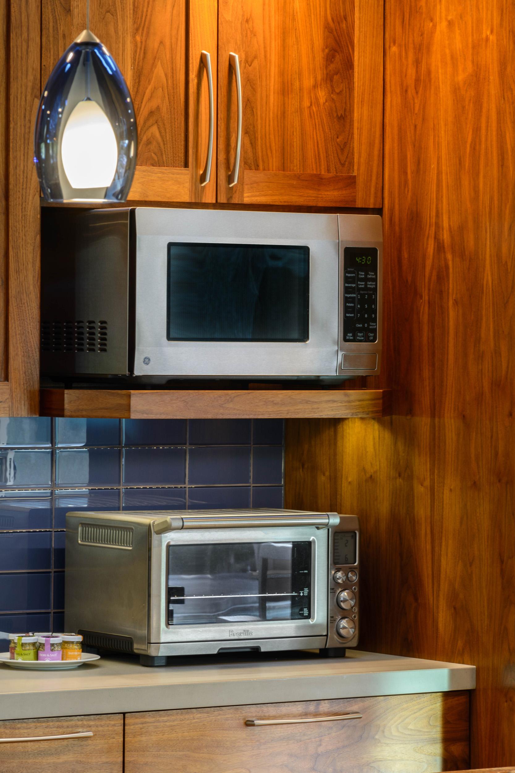 Built-in walnut cabinet shelf for microwave