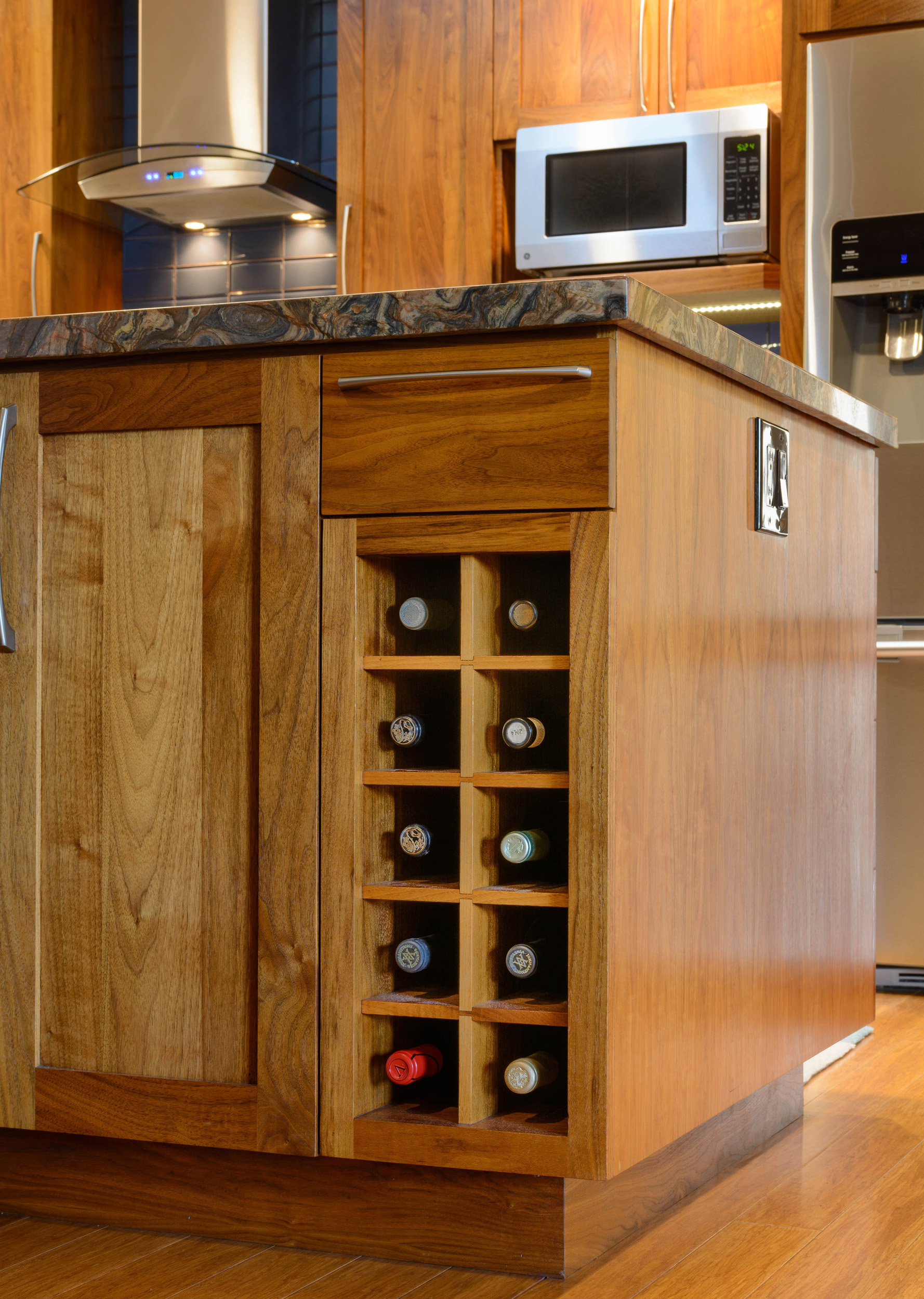 Wine storage within walnut custom-built island