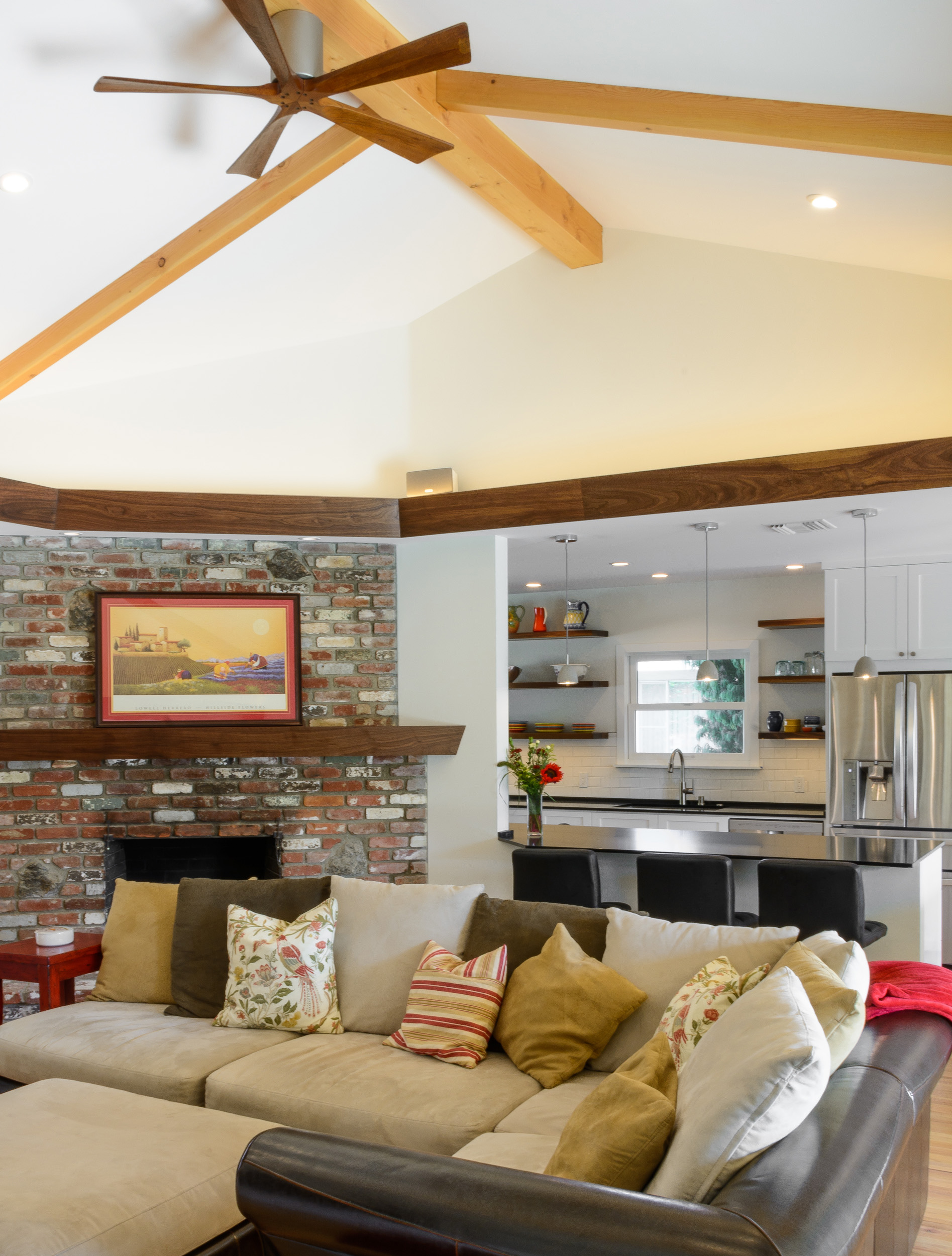 Original brick fireplace with a walnut mantel