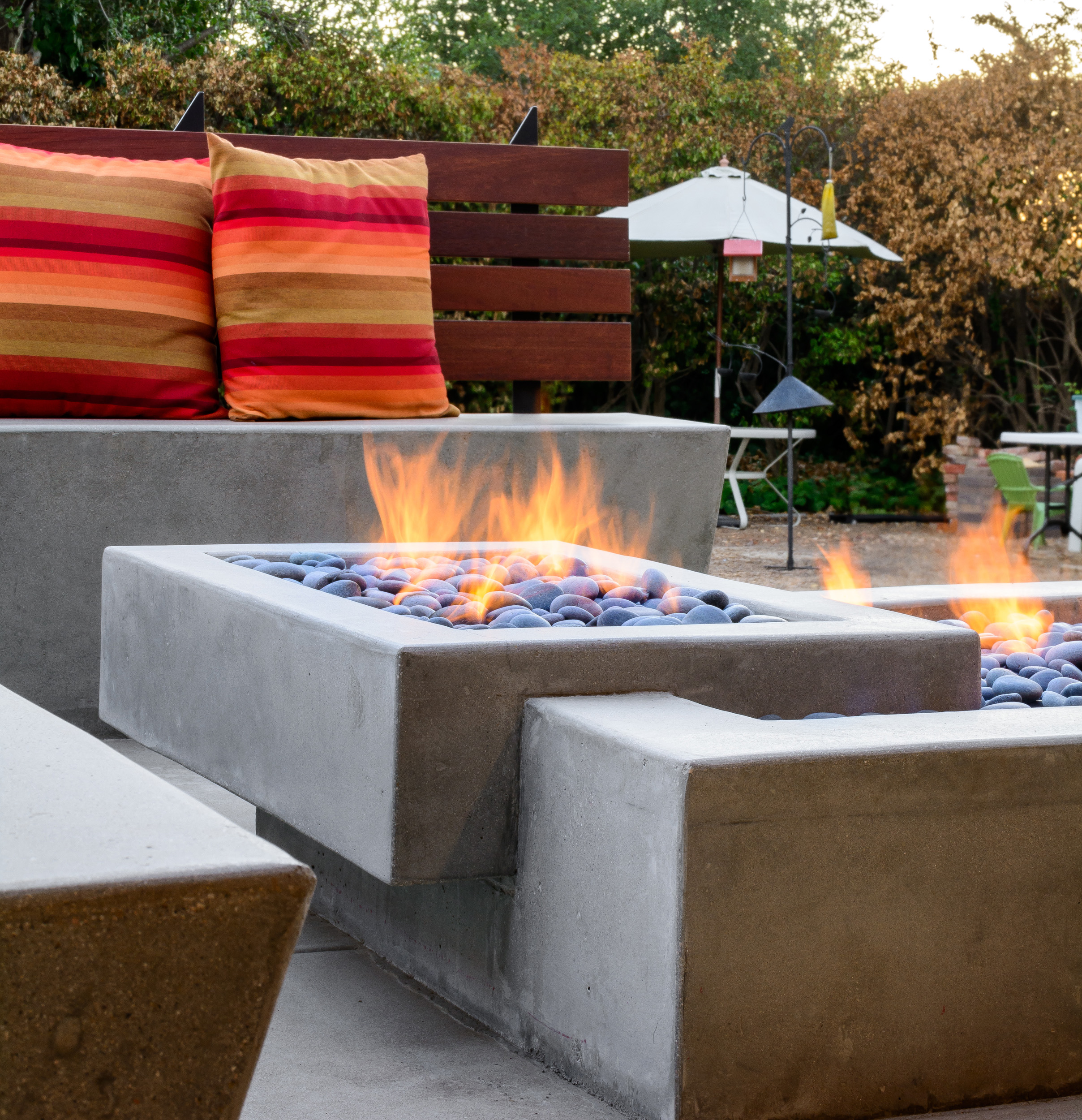 Outside patio with concrete seating and fire pit