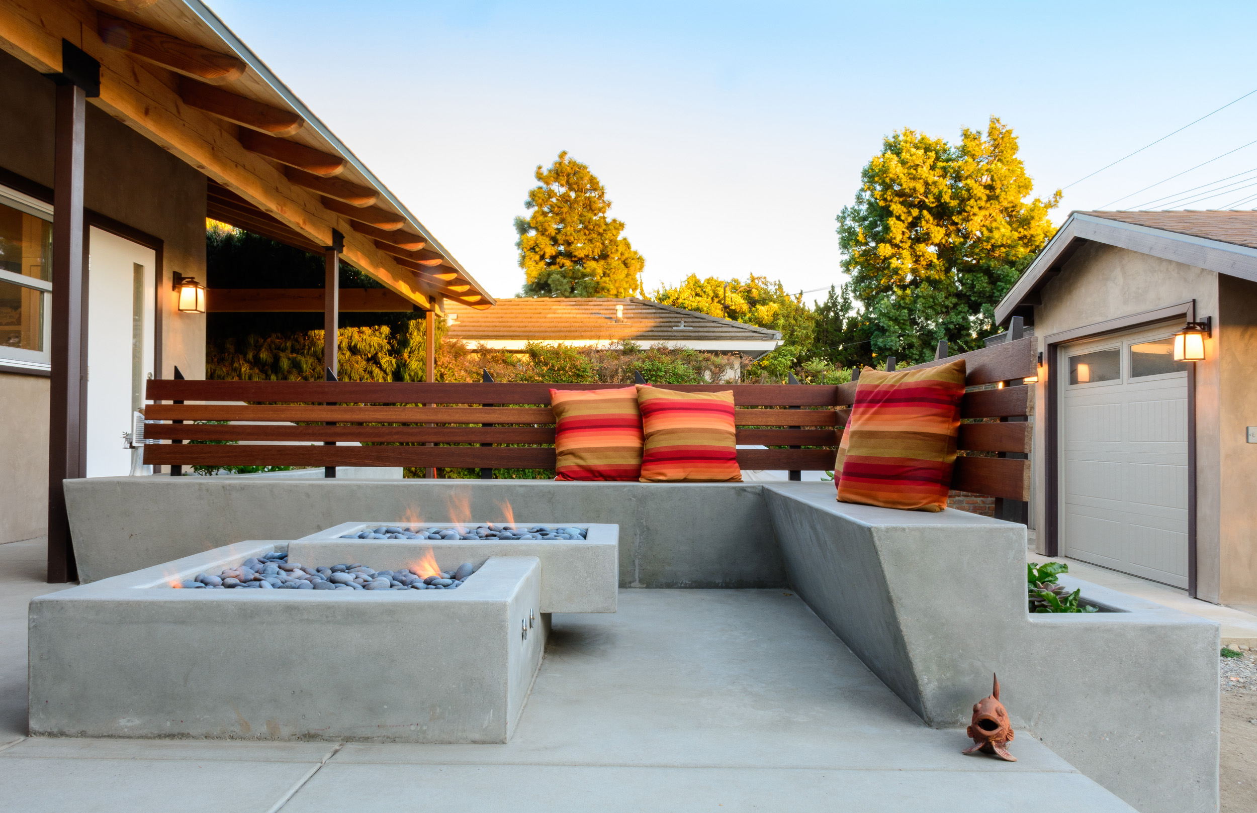 Mid-century ranch back patio deck with concrete seating and fire pit