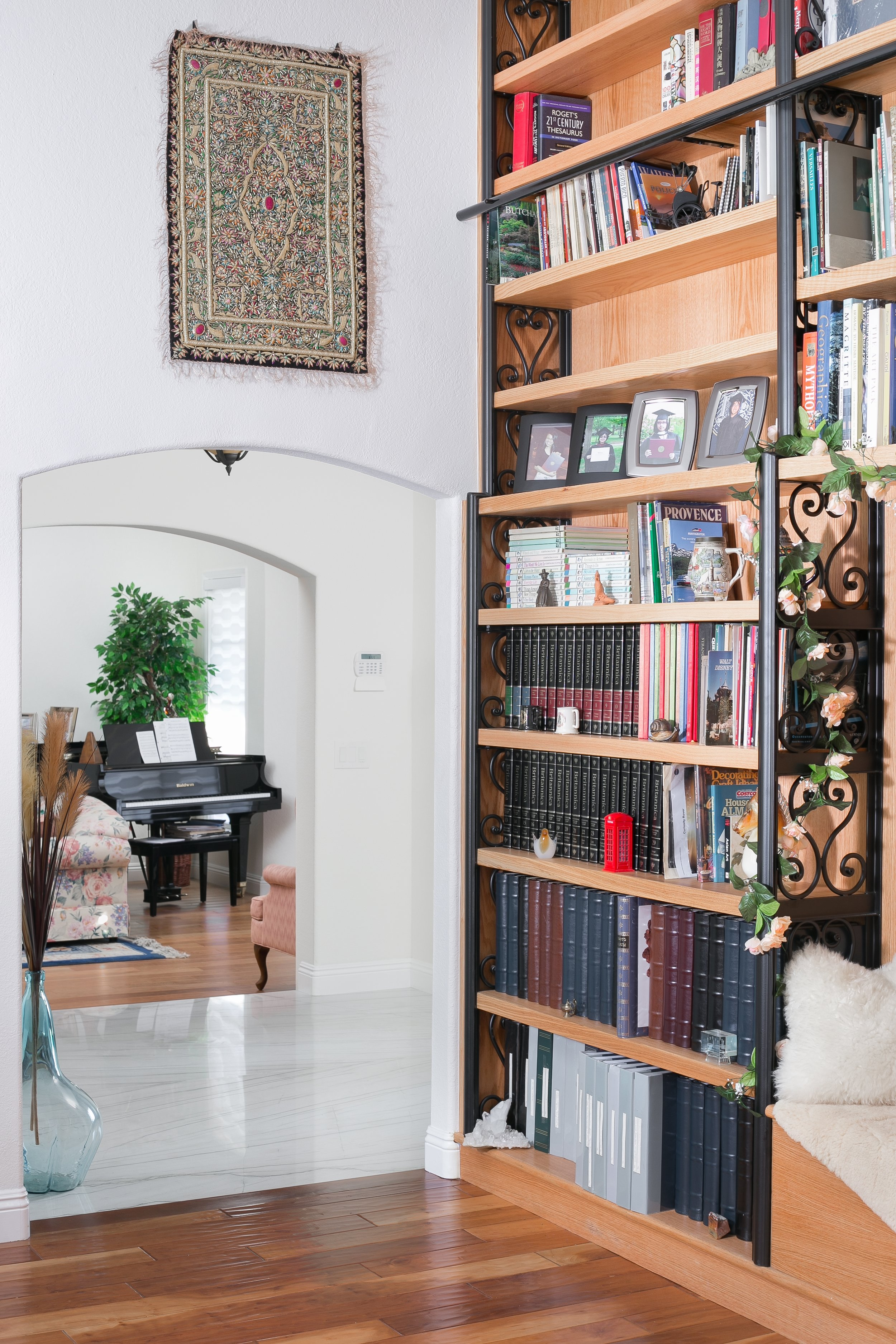 Oak bookshelves with wrought iron detail and a built-in bench