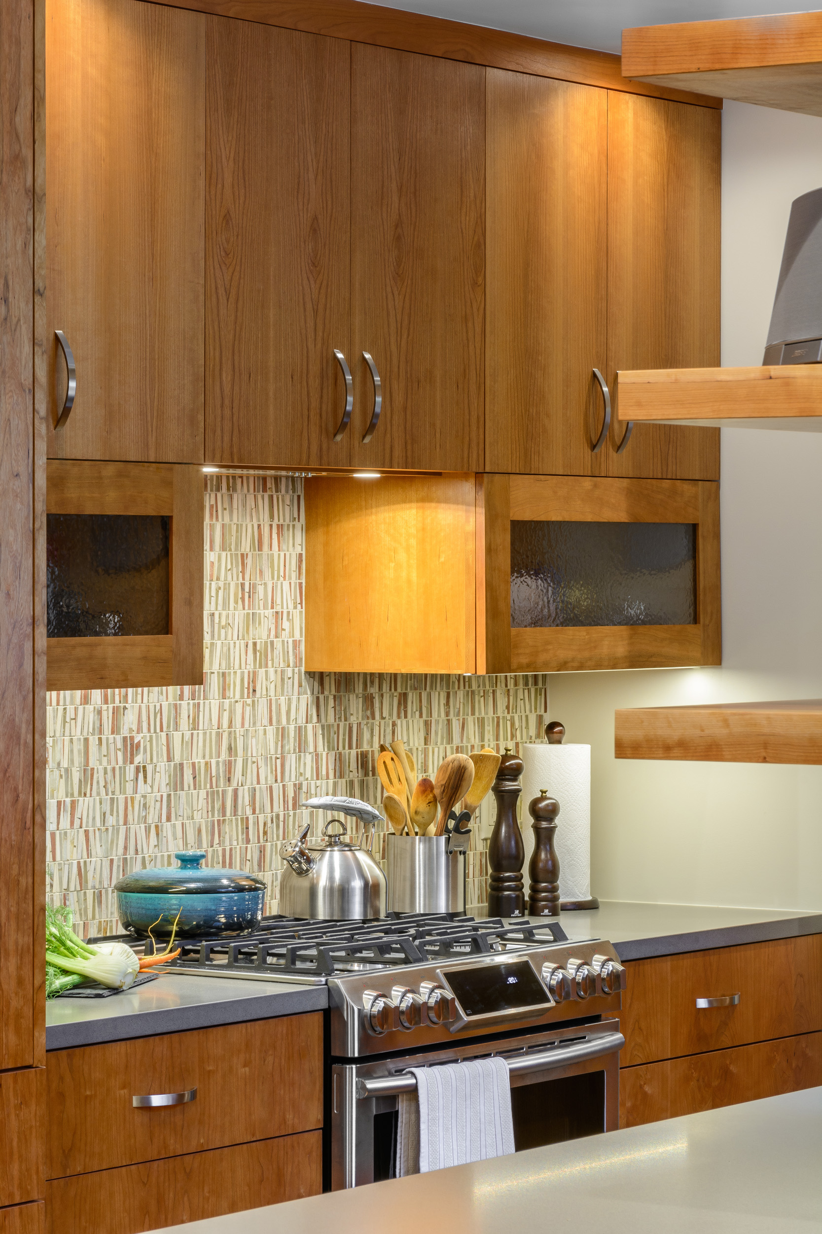 Lots of light for the cooking area of this contemporary kitchen: LED recessed lighting and under cabinet lighting in addition to natural light
