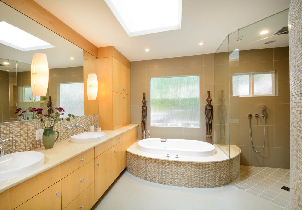 The skylight and rain glass picture window account for plenty of natural light in this spa-like master bathroom