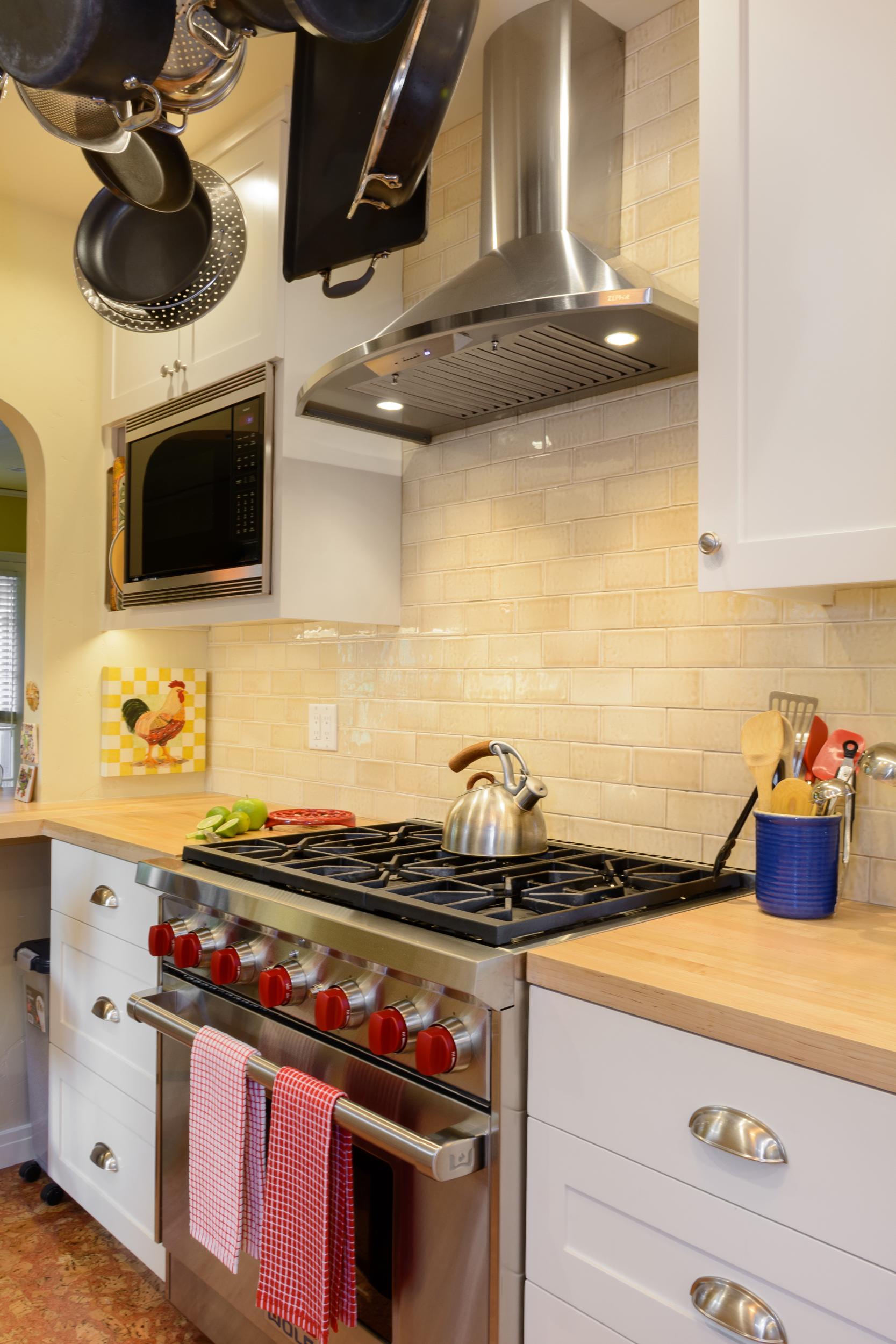 Old-World-Charm-Kitchen-Range-Hood-Tile-Backsplash.jpg