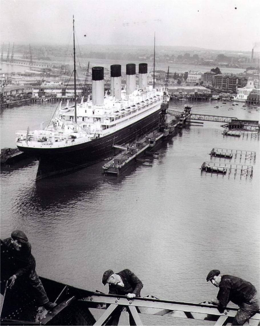 Olympic is in Drydock in this photo. The men in foreground exemplify the bravado of the era as they hang onto scaffolding.