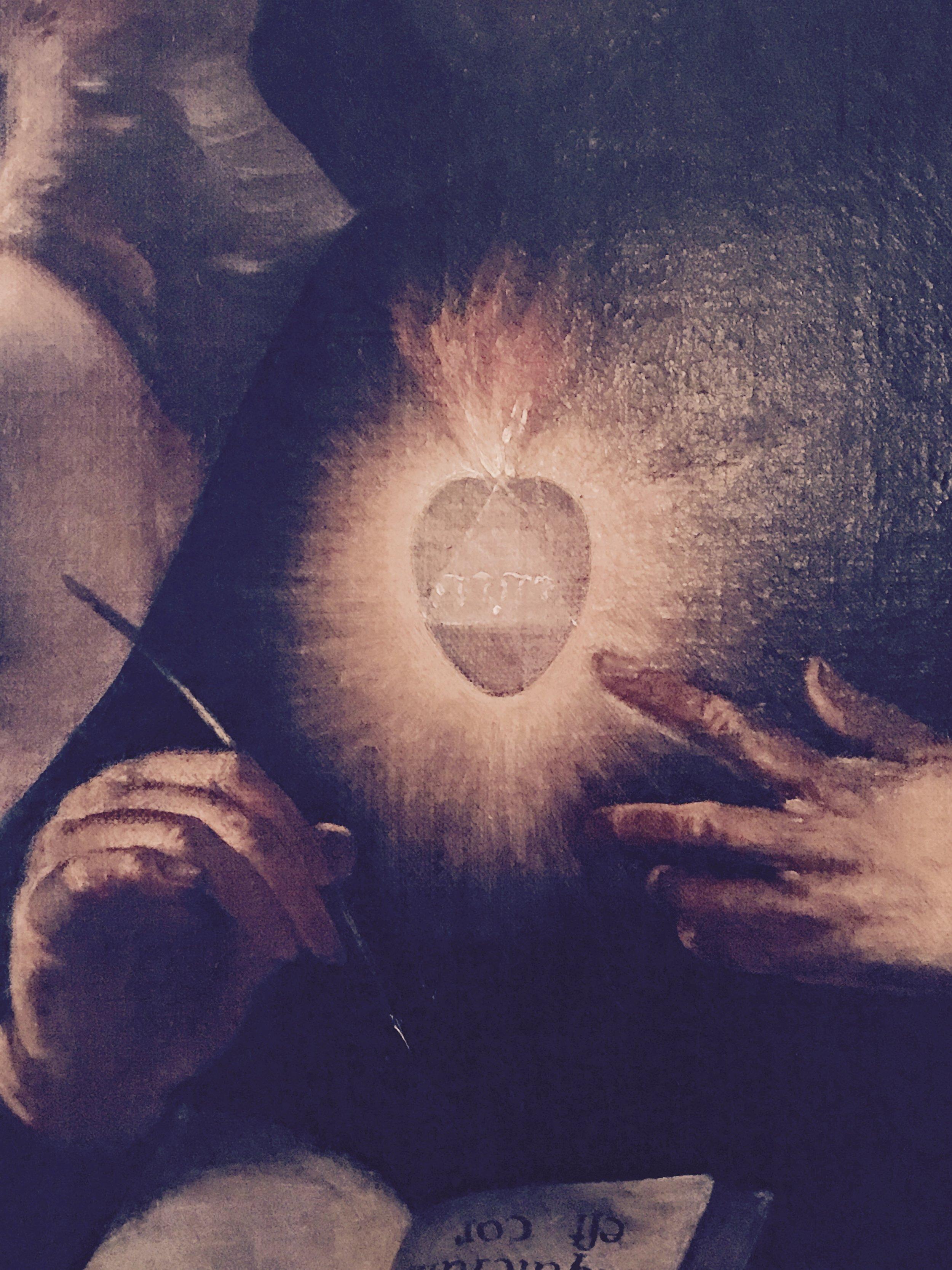 A flaming heart with the Tetragrammaton