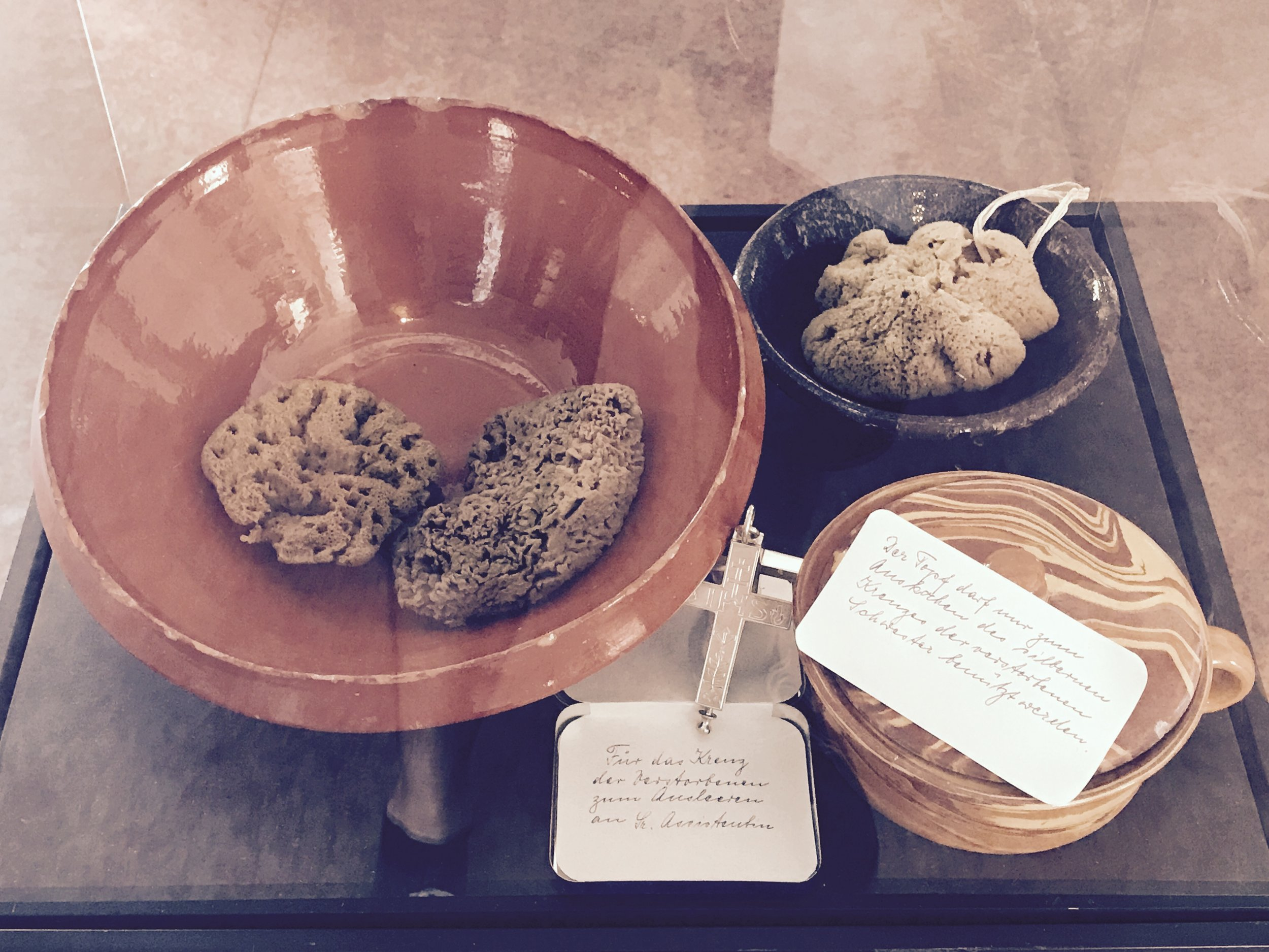 sponges, bowls and oils with clear instructions for washing the dead