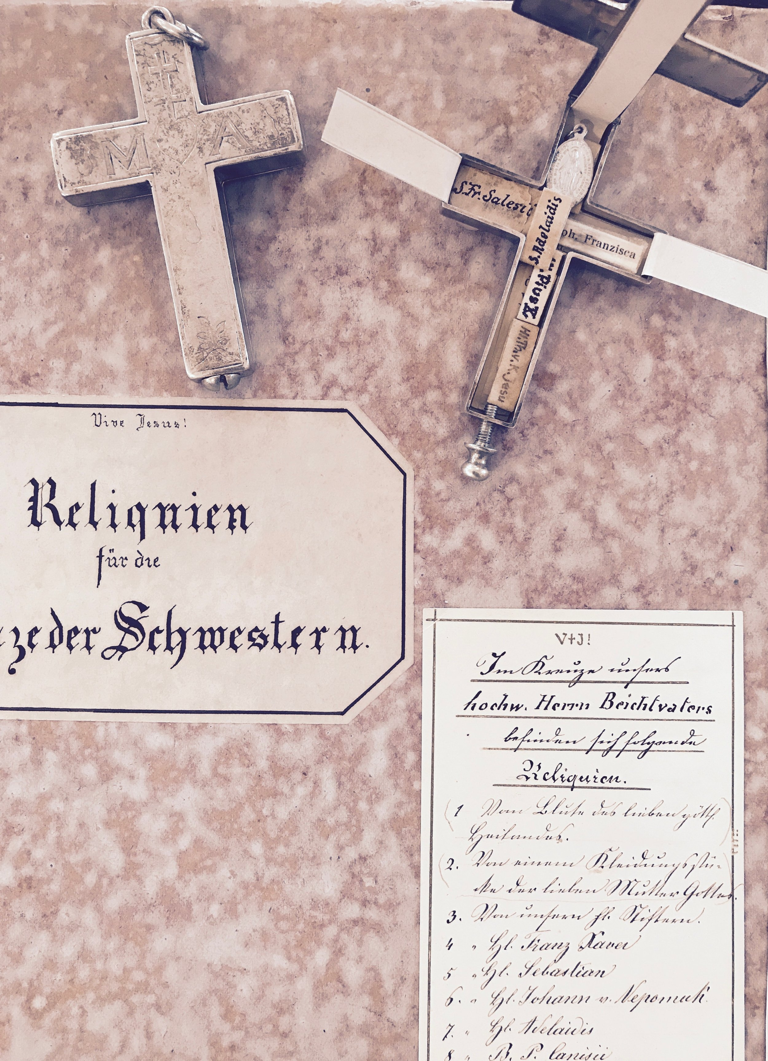 an opened and closed example of the nuns' crosses