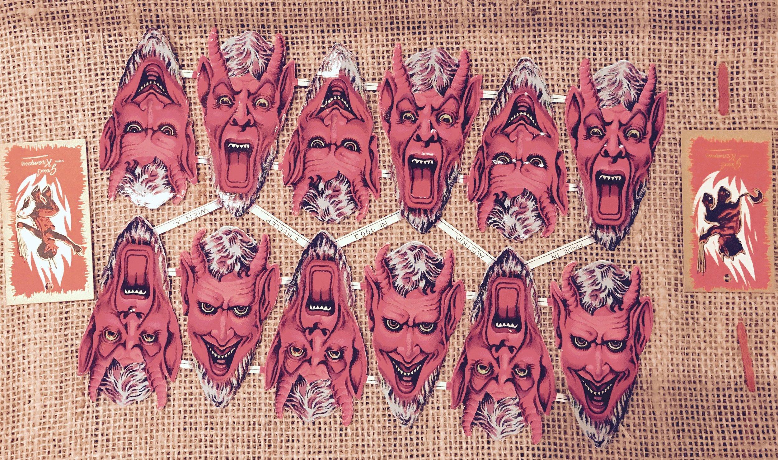 paper-cut krampus masks