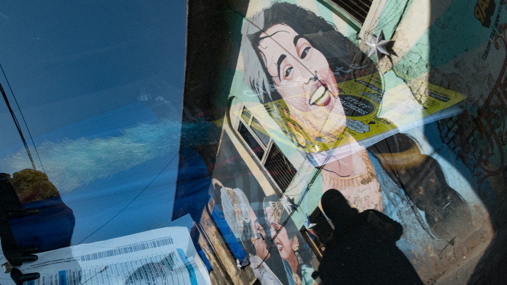 Bollywood Graffiti mirrored in a car window in Bandra, Mumbai, India