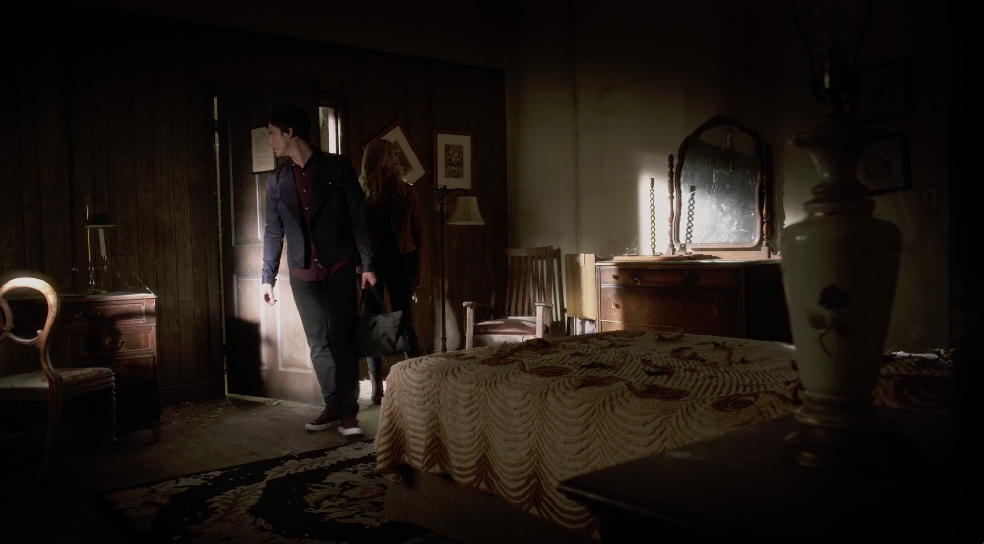 Later, with Hanna at the Lost Woods Resort, he's added this dark jacket with weird lapels to the ensemble.