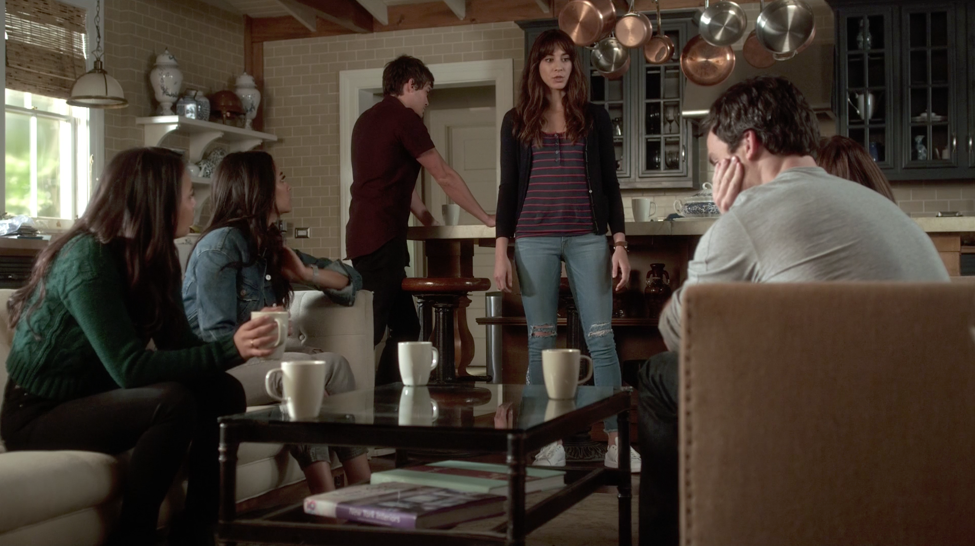 Back at the Hastings House, he's taken the jacket off, but he's still wearing the same jeans and maroon shirt.