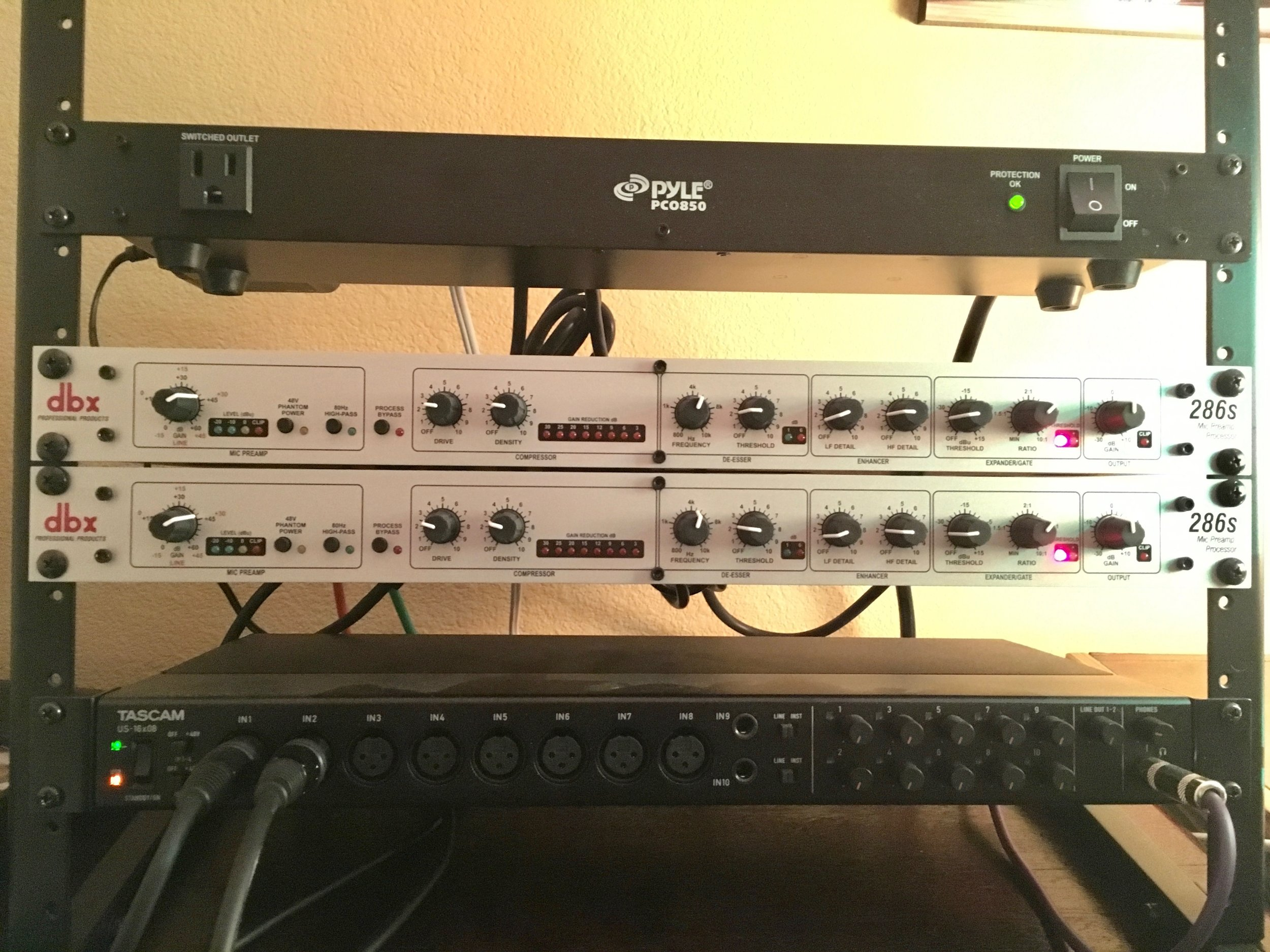 From top to bottom: the Pyle surge protector, two DBX 286s Mic Preamps, and a Tascam US-16x08 USB Audio Interface