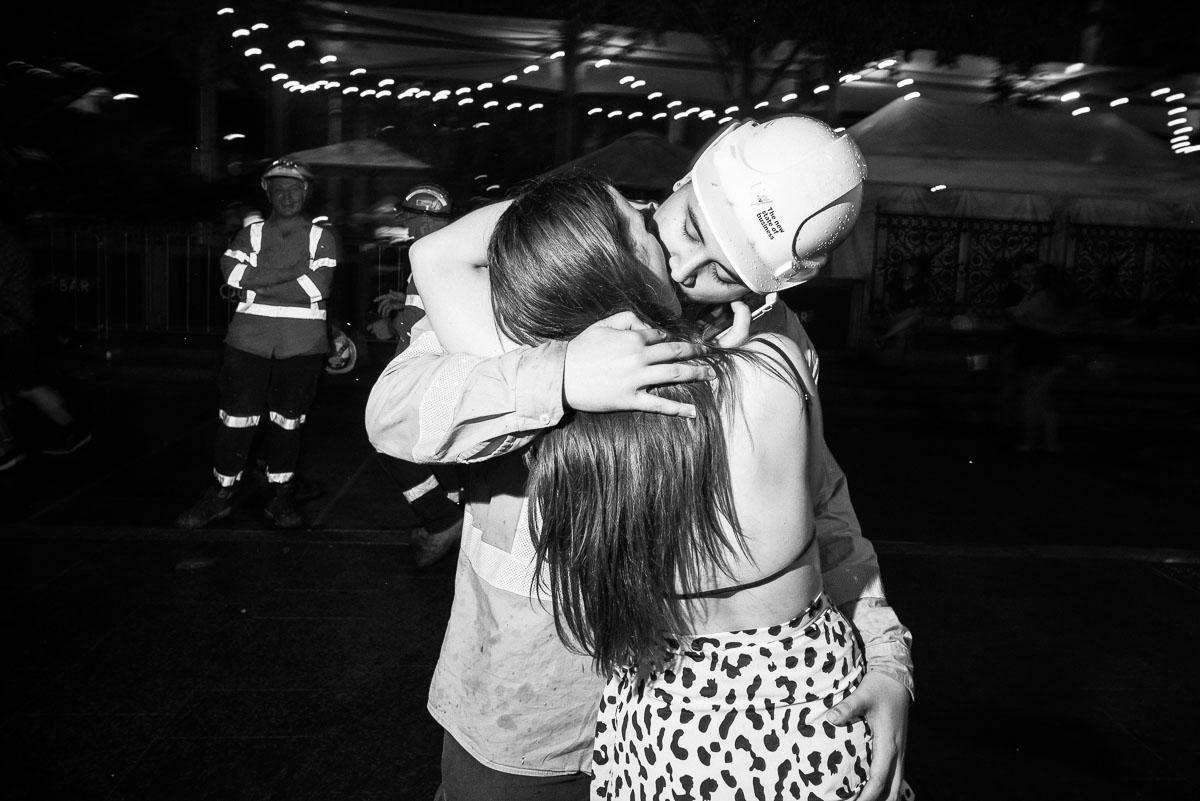 A construction worker steals a kiss at midnight.