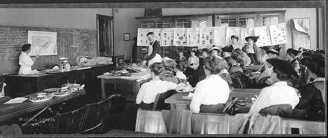 Extension school on meats at Dansville, NY, in 1916. Photo by Wagner Studio, Dansville, and woman instructor is Miriam Birdseye.  -  Cornell University Library