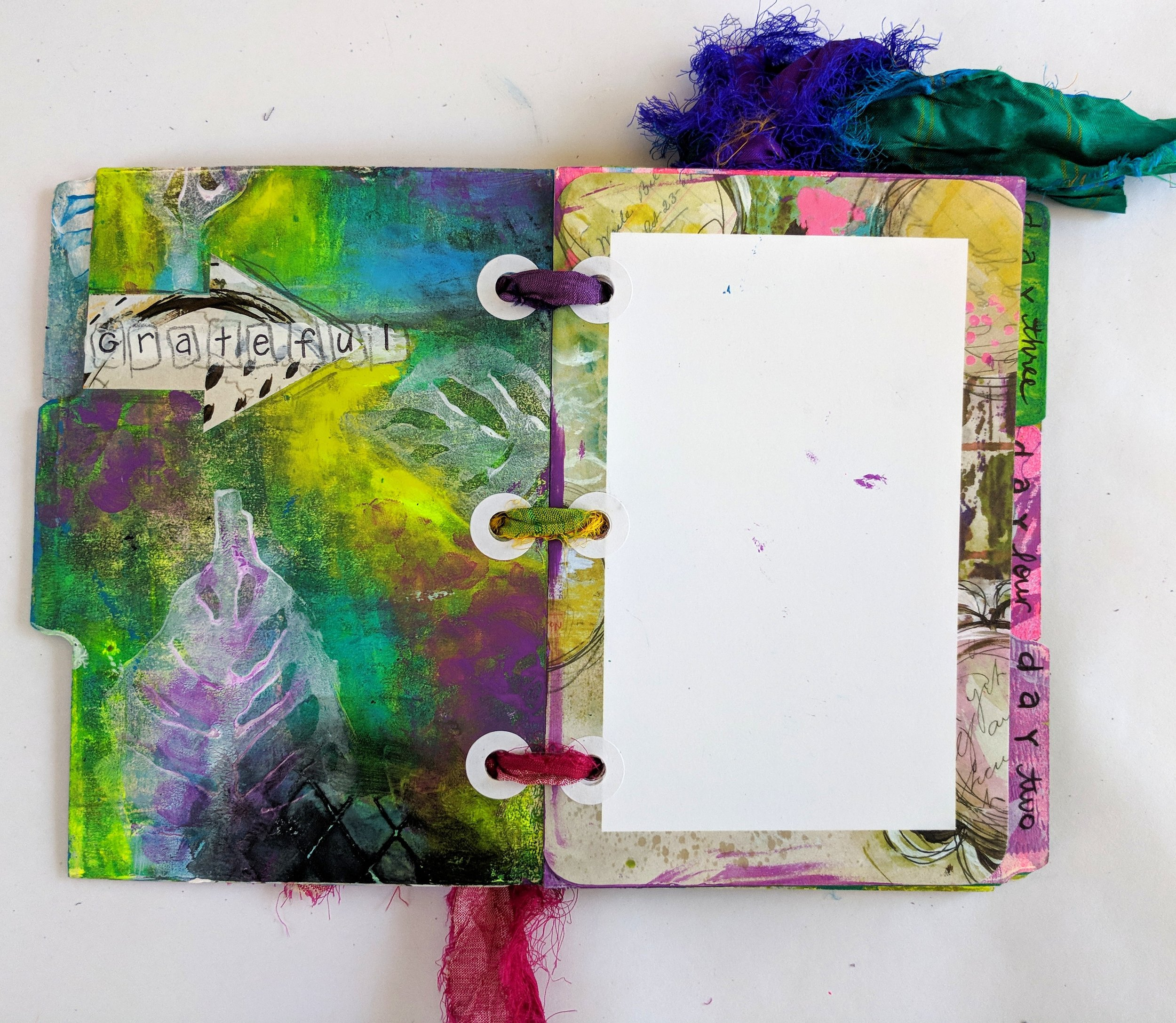 Design Team member Anna Friesen is sharing with how she made this beautiful mixed media Gratitude. We are all guilty of not stopping to appreciate all that we have and what better way to fix this than with this little journal? Follow along with her video tutorial as she creates something which is sure to make you the hit of the party! She uses Art Pops™ and Paperbag Studio Stamps to create this gorgeous piece of Art! @robenmarie @annafriesen #robenmarie #robenmariedesignteam #paperbagstudios #artpops #mixedmedia #diy