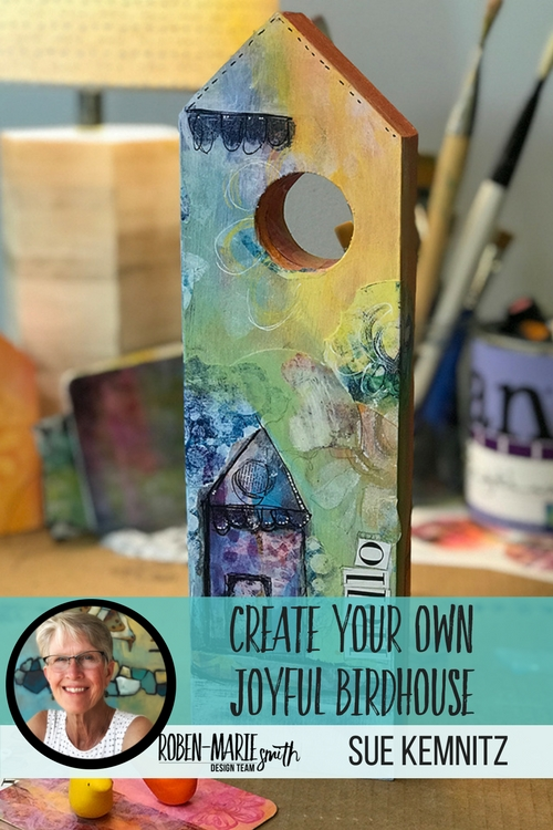 Check out this video tutorial as Design Team member Sue Kemnitz creates this joyful little bird house as her project. Sue takes you step by step through creating this house to grace the entrance of your home. She uses Art Pops™ and Paperbag Studios Stamps. @robenmarie @suekemnitzart #robenmarie #robenmariedesignteam #paperbagstudios #artpops #mixedmedia #diy