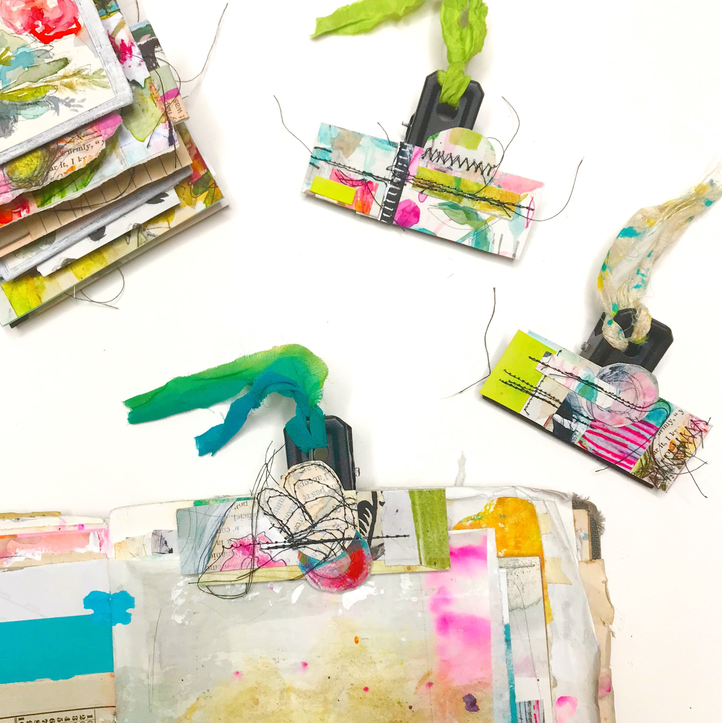Mixed media art tutorial by Roben-Marie Smith. DIY handmade, custom collaged and stitched paper bits to create these unique binder clips. A unique art journaling accessory and perfect gift idea. #robenmariesmith #artbits #artaccessory #mixedmediatutorial