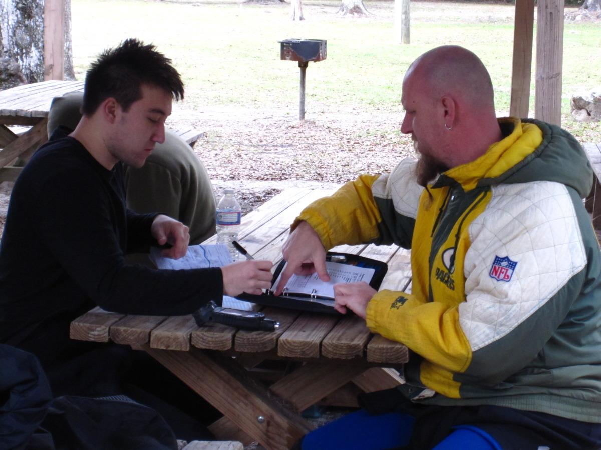 Tige and James doing logbooks
