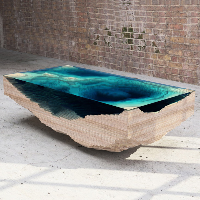 Modeled after a cross-section of the ocean's surface. This is one cool-looking table.   (Via  Boing Boing )