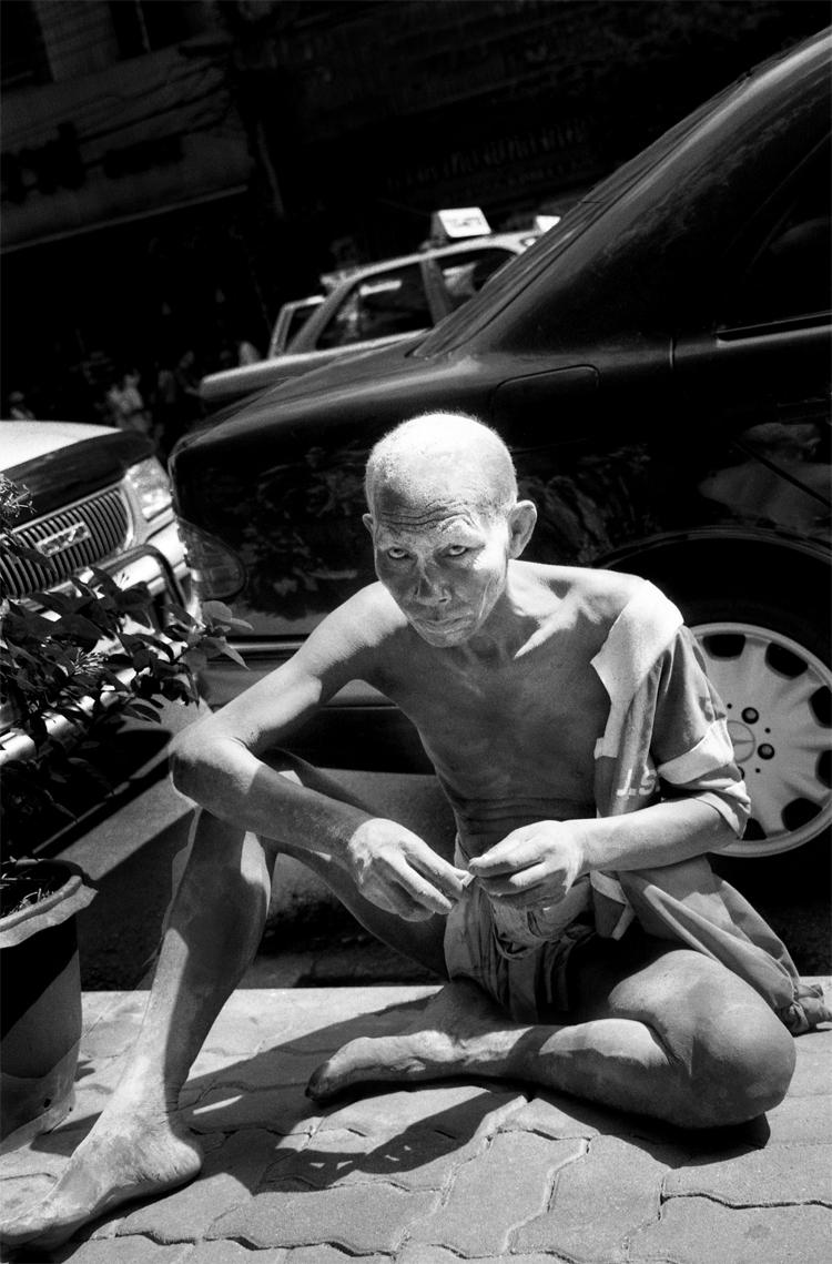Beggar Beside The Mercedes benz