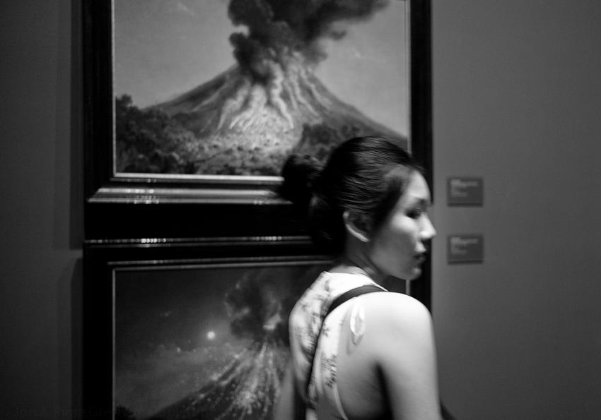 Lady walking away from Raden Saleh's volcanoes
