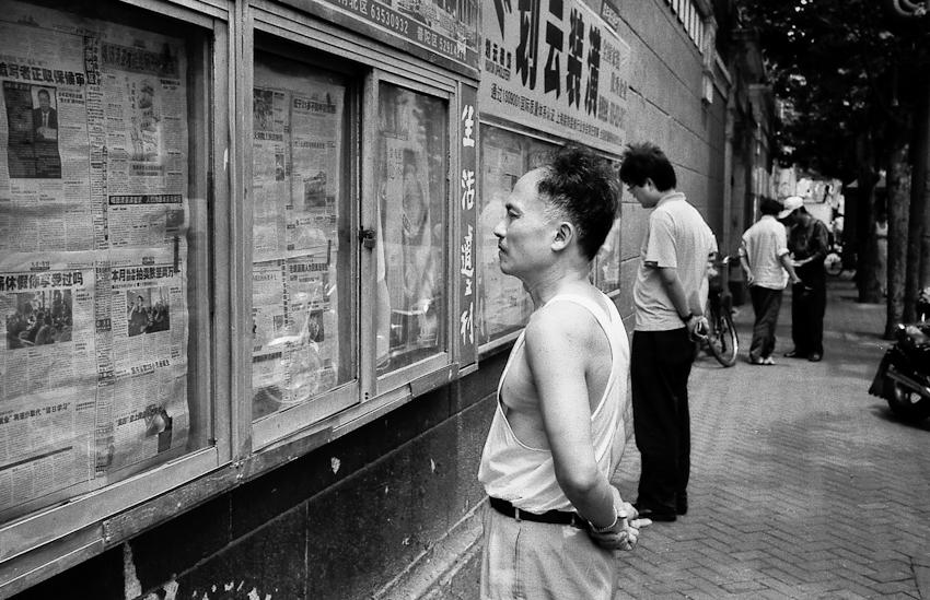 Reading the news, Shanghai, 2008
