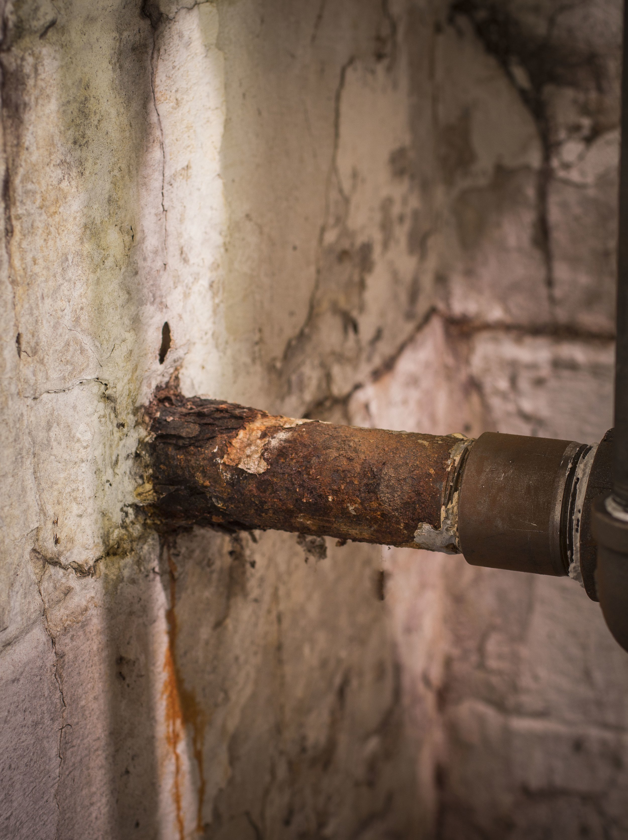 Pipe to the gas meter. Although it looks neglected, a new pipe was recently run inside of this corroded mess.