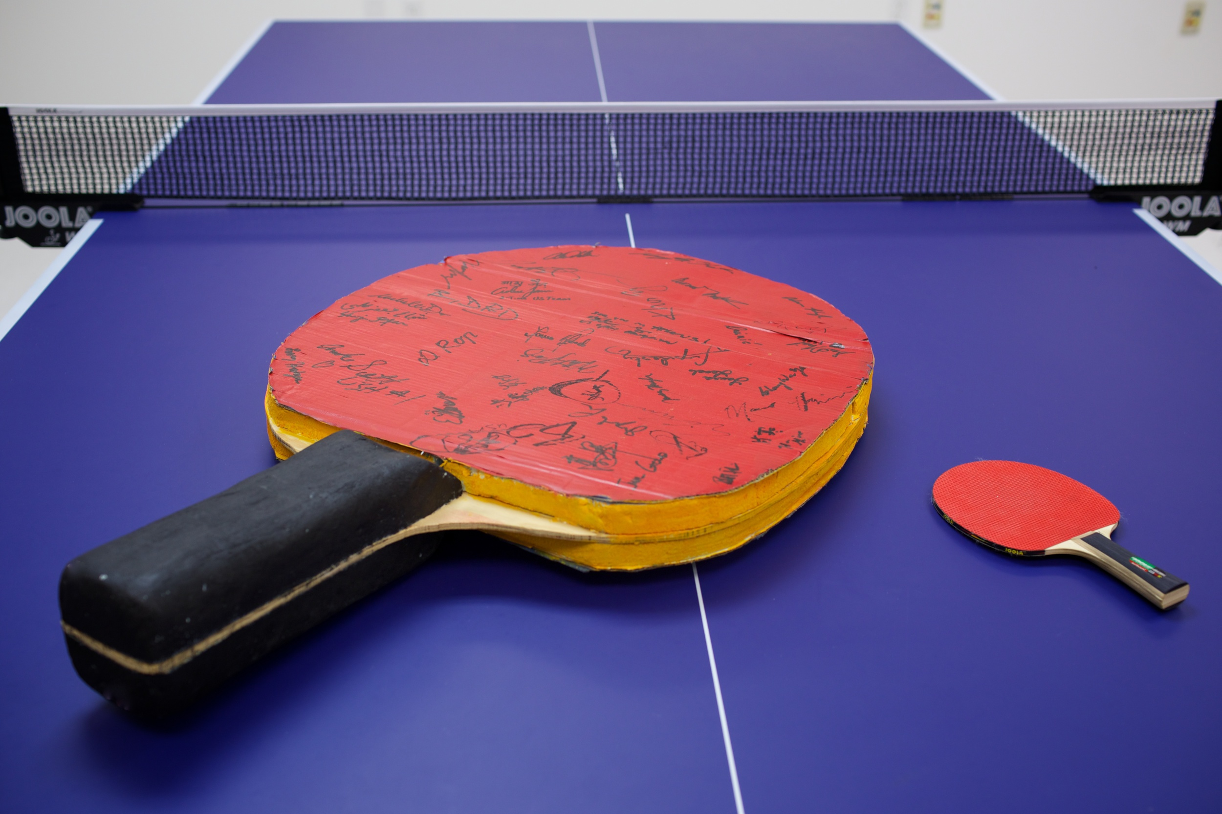 A monumental racket signed by the 2004 US Olympic Table Tennis Trials participants.
