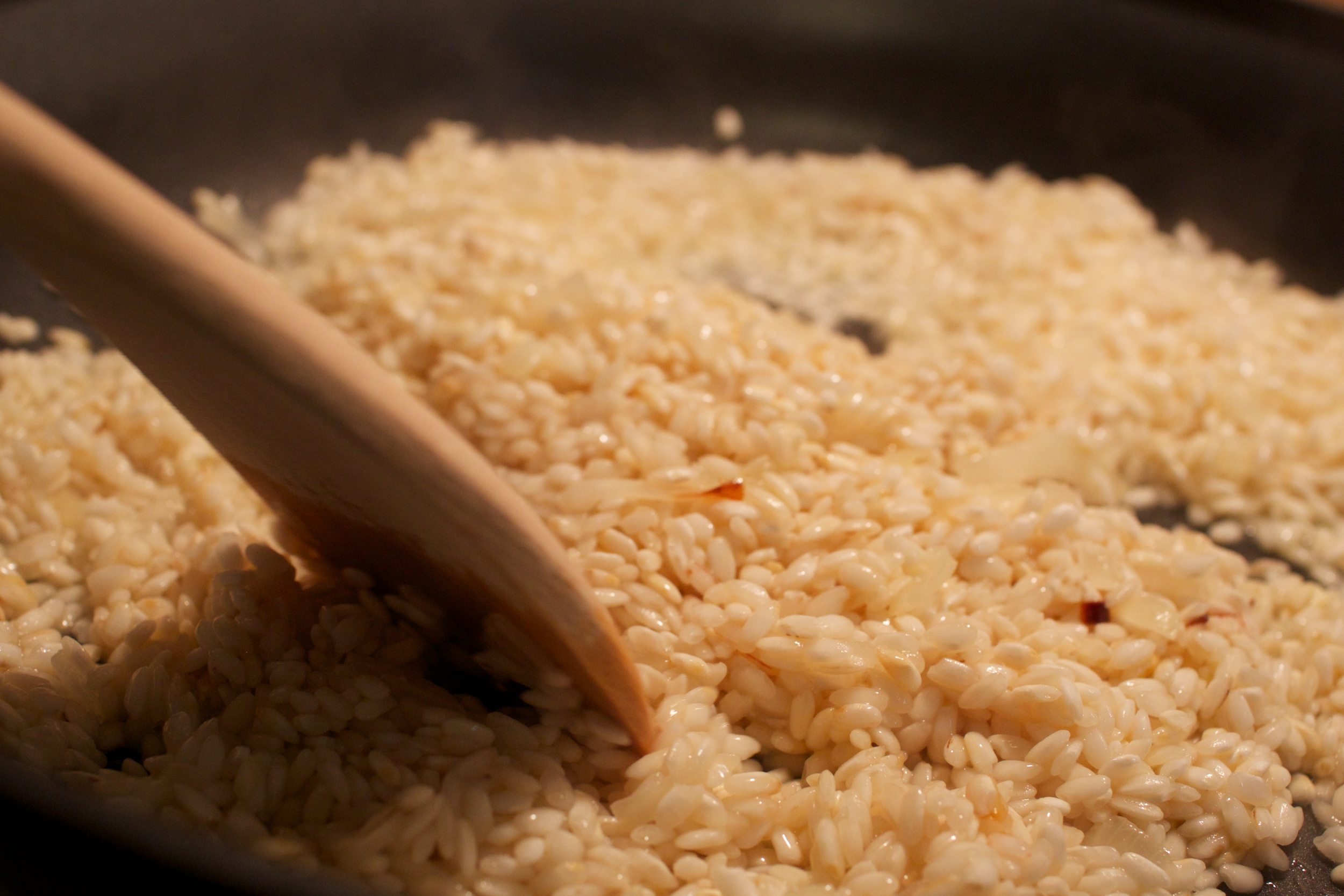 After we sautéed the onions, we added the arborio rice