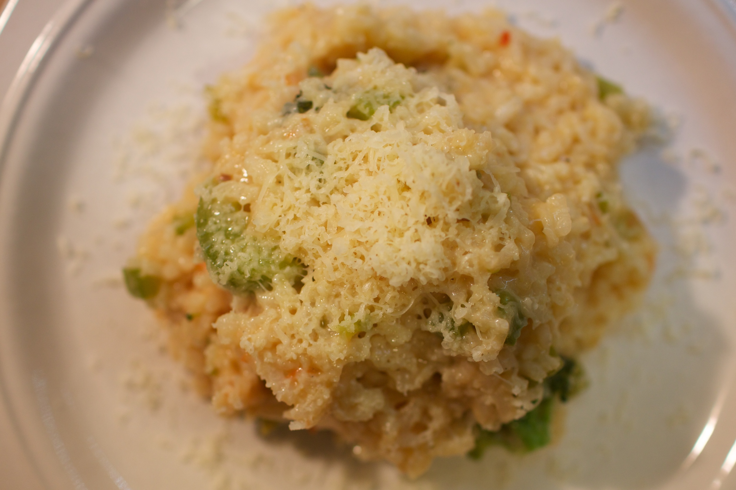 Adding some freshly grated parmesan cheese on top