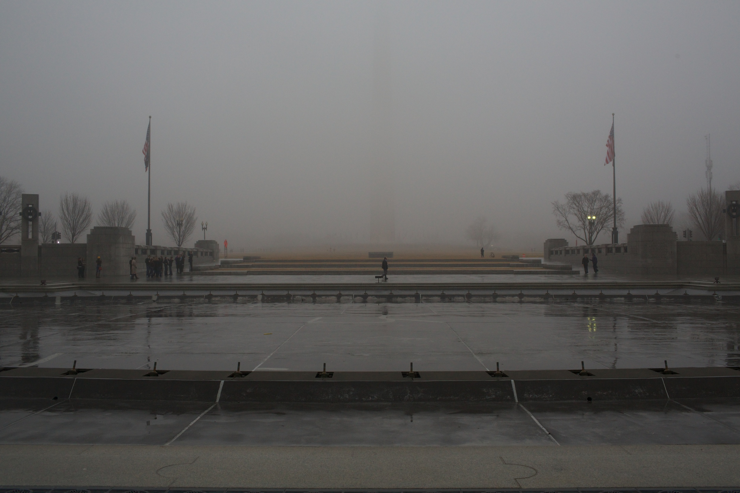 A barely visible Washington Monument by the World War II Memorial