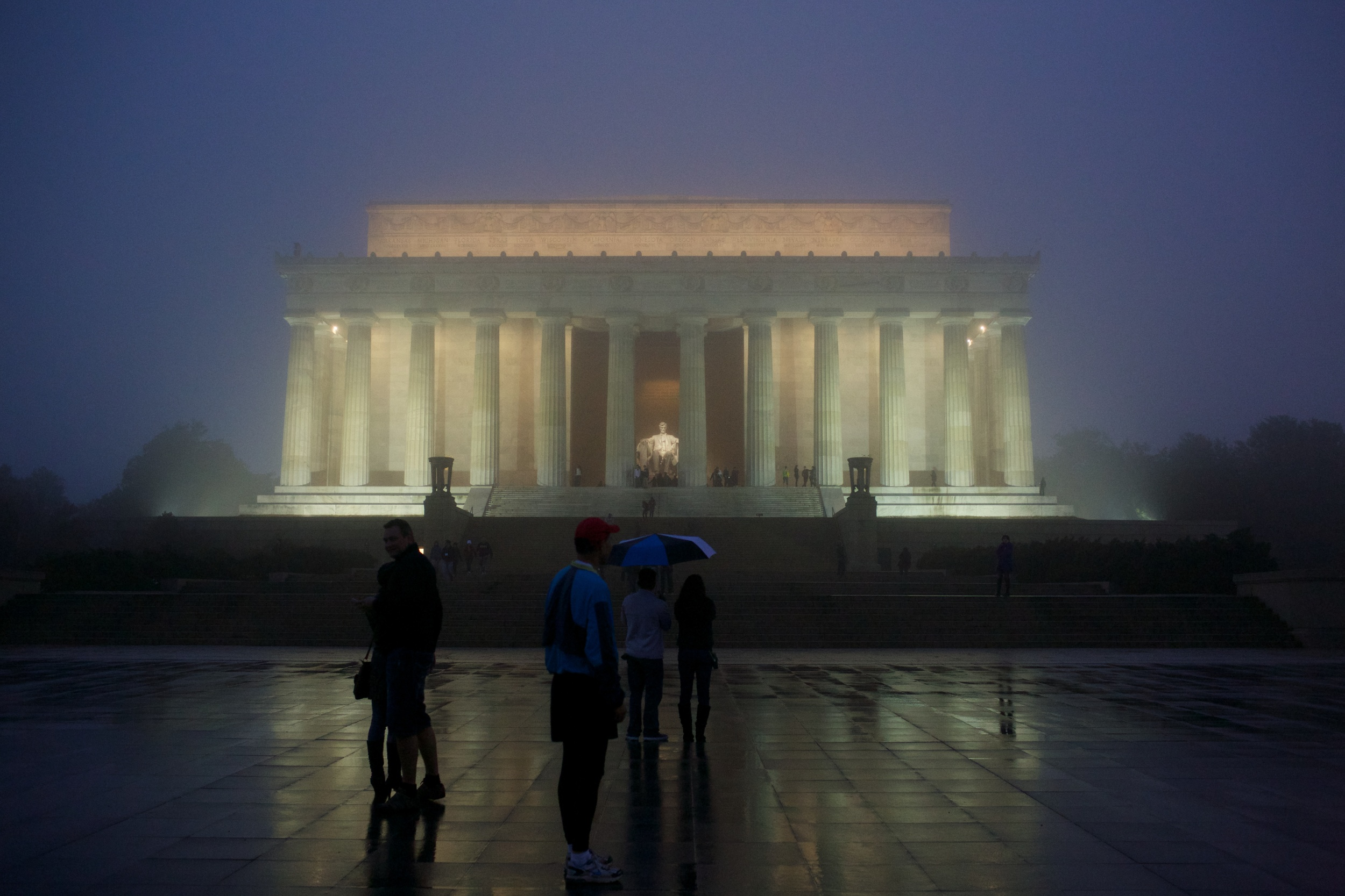 The Lincoln Memorial glowing on a foggy night in Washington DC