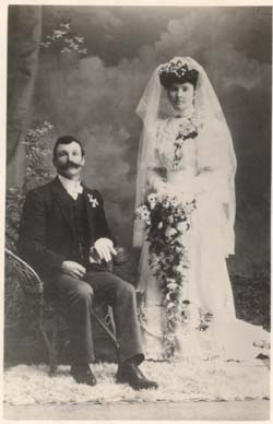Henry Alfred and Eva Emily Wood (nee Ford)  Taken on the marriage of my great uncle and aunt on 5 July 1906. My grandmother, Sarah Ann Ford, was bridesmaid.