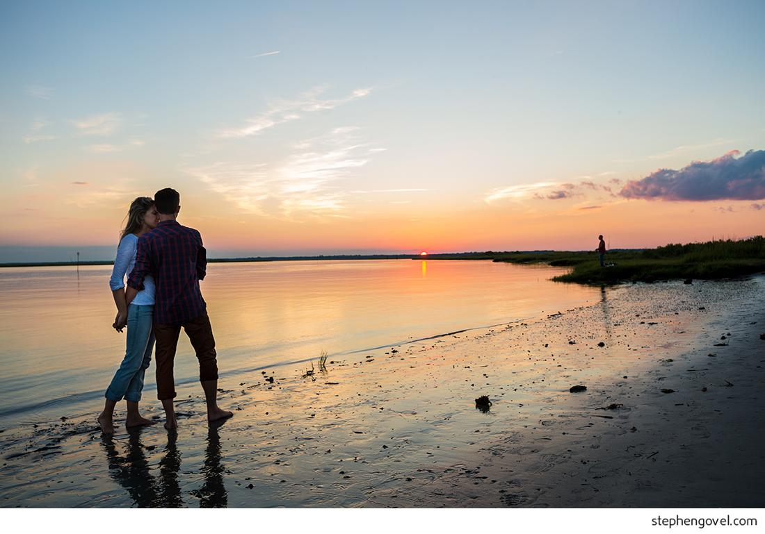 ocean city engagement photos sunset water beach boardwalk bikes marsh reflections